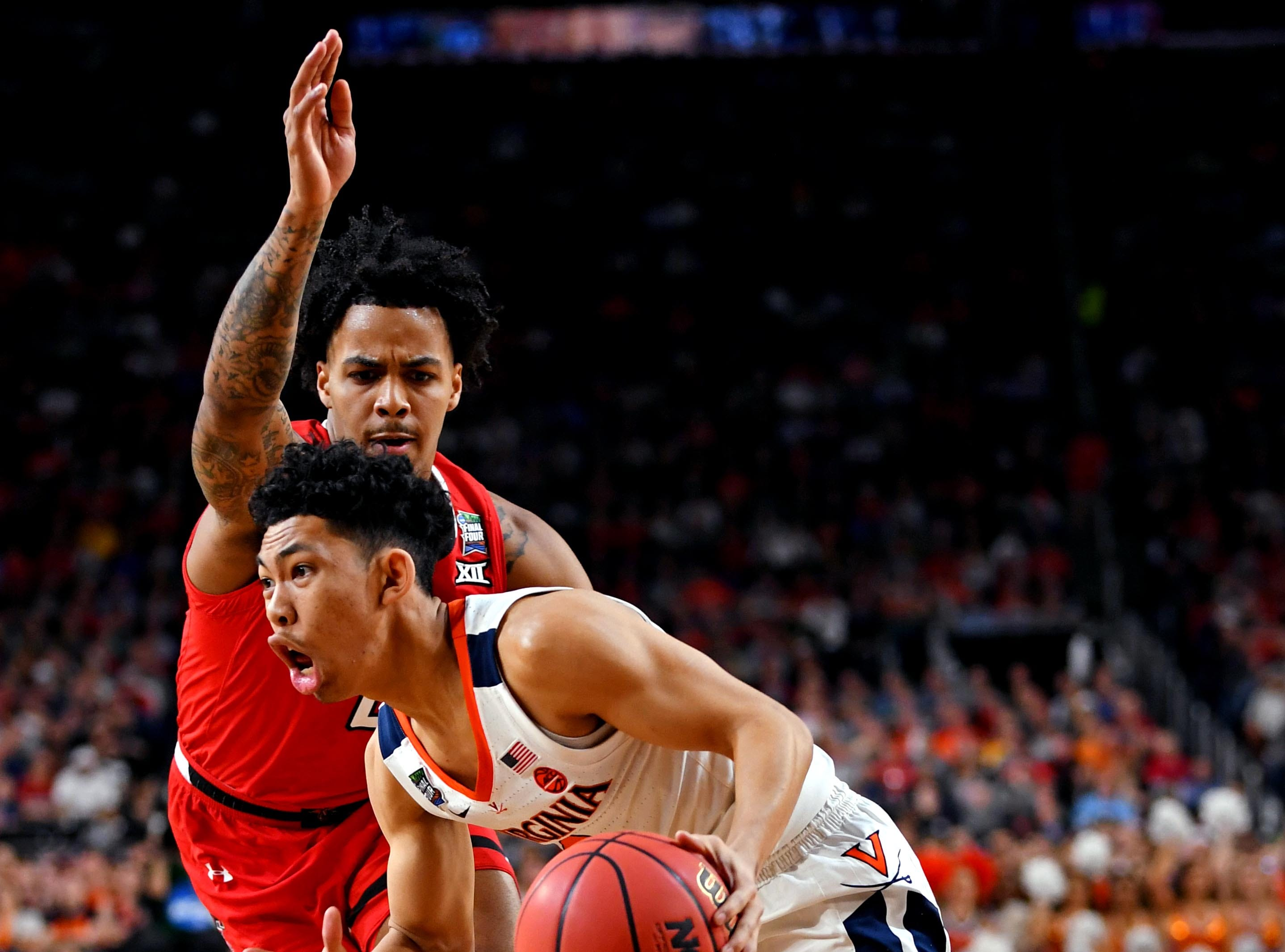 Apr 8, 2019; Minneapolis, MN, USA; Virginia Cavaliers guard Kihei Clark (0) drives to the basket against Texas Tech Red Raiders guard Kyler Edwards (0) during the first half in the championship game of the 2019 men's Final Four at US Bank Stadium. Mandatory Credit: Bob Donnan-USA TODAY Sports