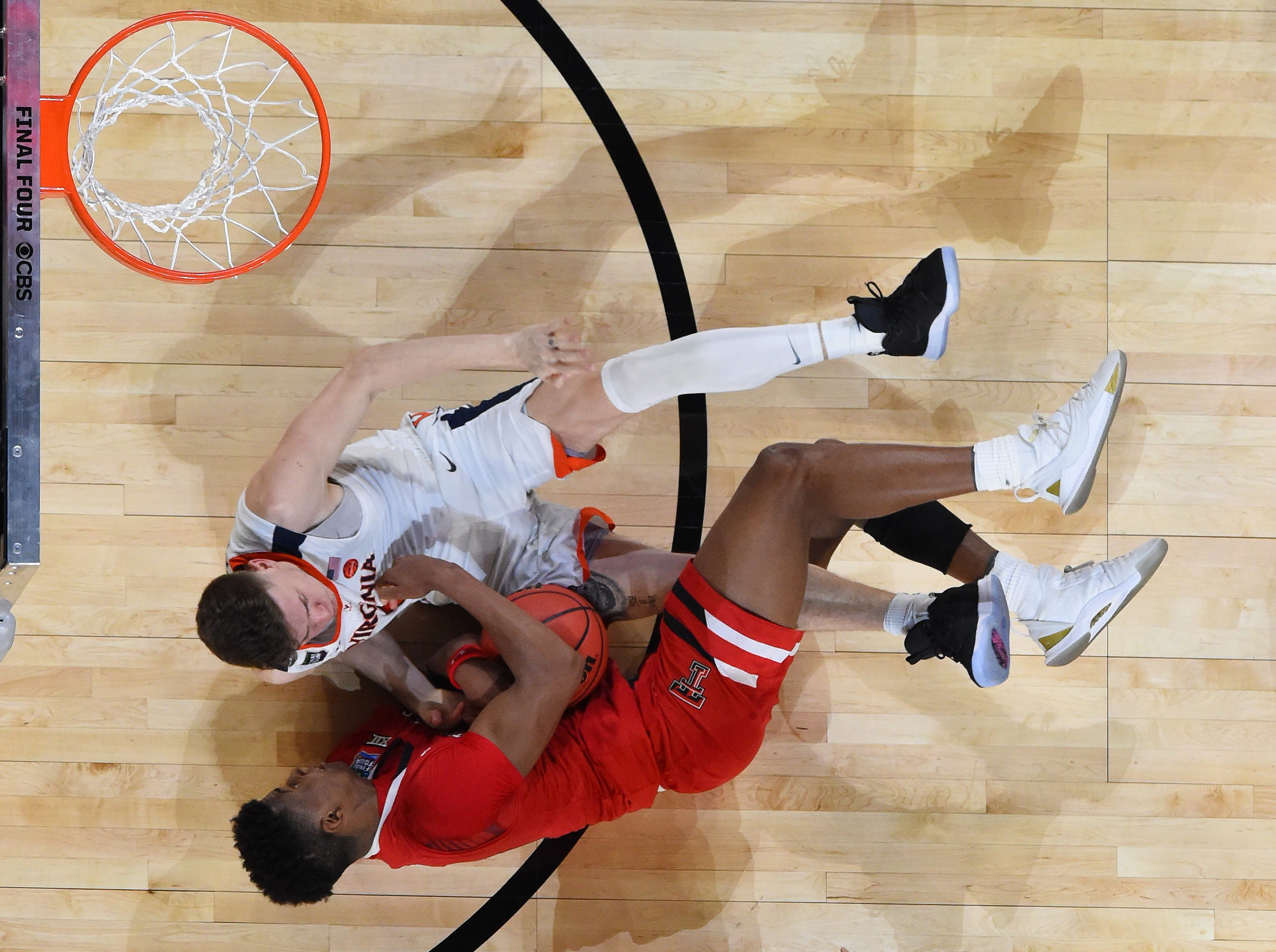 Apr 8, 2019; Minneapolis, MN, USA; Texas Tech Red Raiders guard Jarrett Culver (23) forces a jump ball with Virginia Cavaliers guard Kyle Guy (5) during the second half in the championship game of the 2019 men's Final Four at US Bank Stadium. Mandatory Credit: Bob Donnan-USA TODAY Sports