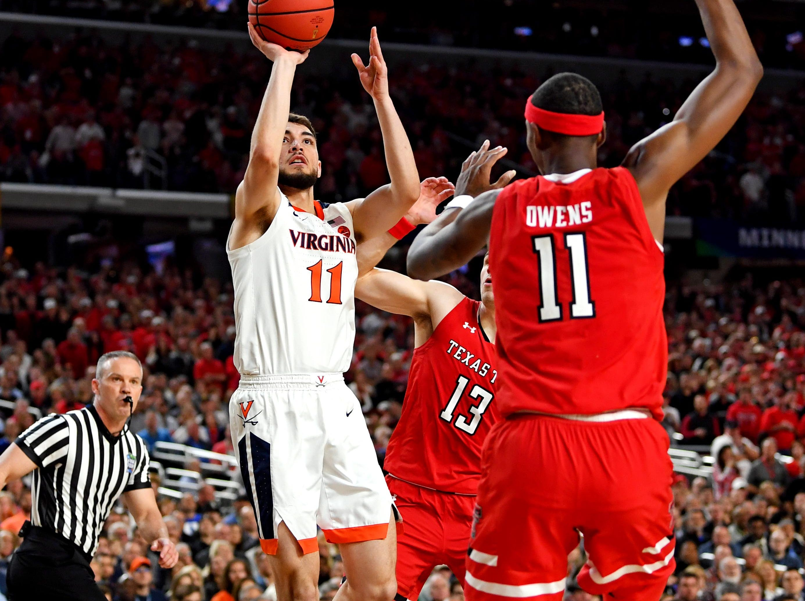 Apr 8, 2019; Minneapolis, MN, USA; Virginia Cavaliers guard Ty Jerome (11) shoots the ball against Texas Tech Red Raiders forward Tariq Owens (11) during the first half in the championship game of the 2019 men's Final Four at US Bank Stadium. Mandatory Credit: Bob Donnan-USA TODAY Sports
