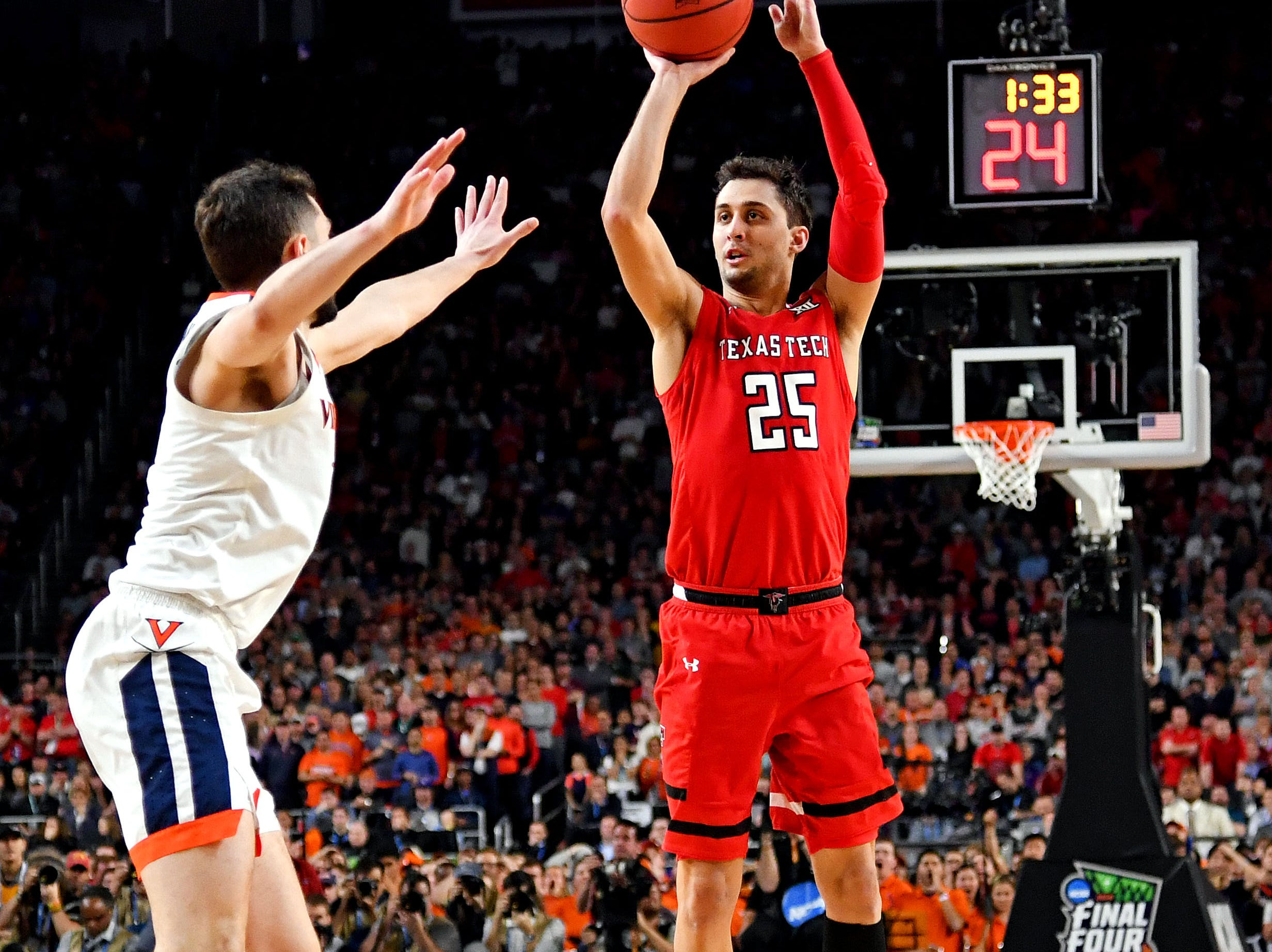 Apr 8, 2019; Minneapolis, MN, USA; Texas Tech Red Raiders guard Davide Moretti (25) shoots the ball during the second half against Virginia Cavaliers guard Ty Jerome (11) in the championship game of the 2019 men's Final Four at US Bank Stadium. Mandatory Credit: Bob Donnan-USA TODAY Sports