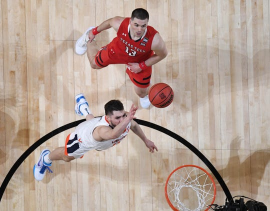 Apr 8, 2019; Minneapolis, MN, USA; Virginia Cavaliers guard Ty Jerome (11) shoots over Texas Tech Red Raiders guard Matt Mooney (13) in overtime in the championship game of the 2019 men's Final Four at US Bank Stadium. Mandatory Credit: Robert Deutsch-USA TODAY Sports