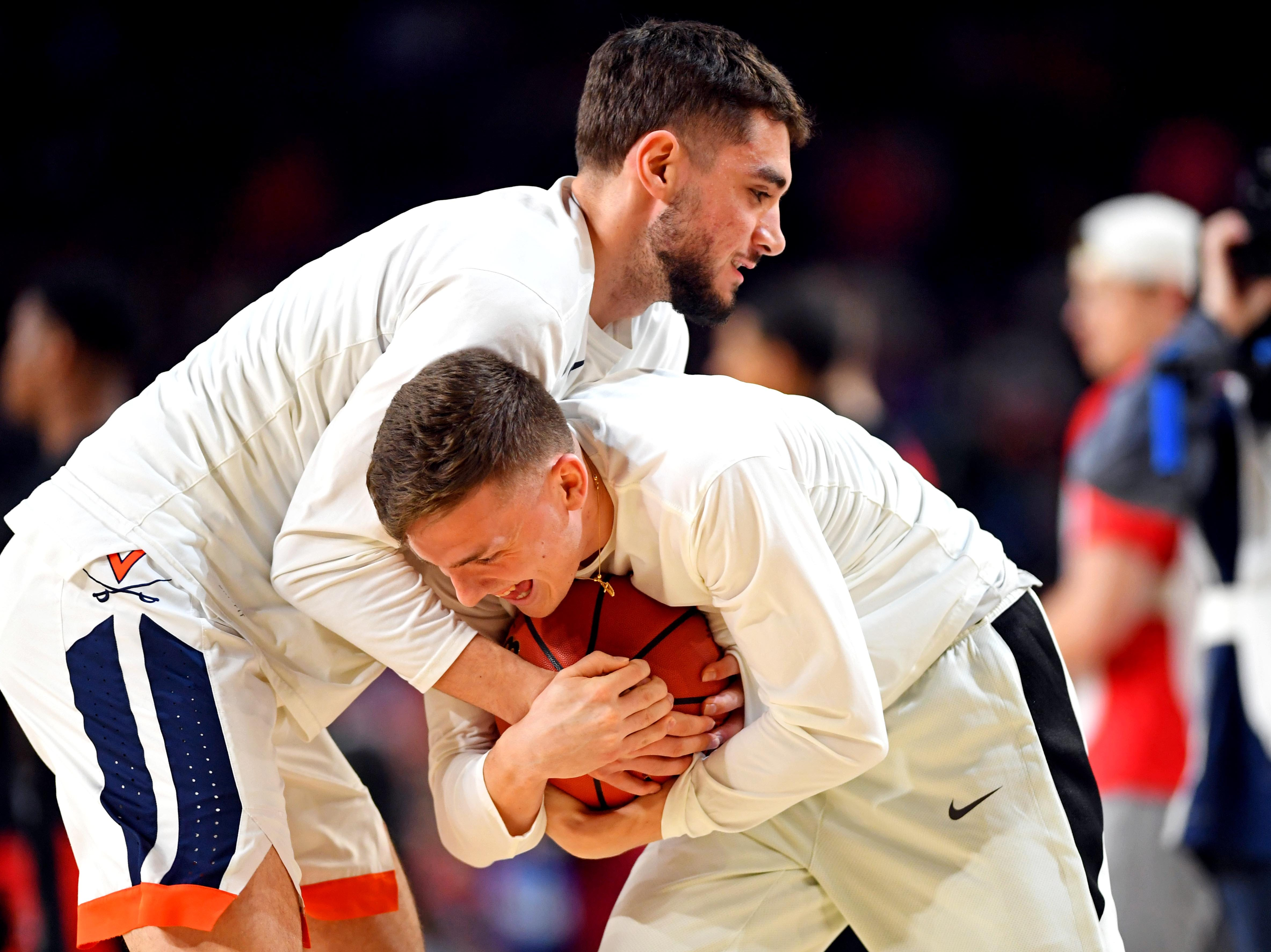 Apr 8, 2019; Minneapolis, MN, USA; Virginia Cavaliers guard Ty Jerome (11) and guard Kyle Guy (5) warms up before the game against the Texas Tech Red Raiders in the championship game of the 2019 men's Final Four at US Bank Stadium. Mandatory Credit: Bob Donnan-USA TODAY Sports