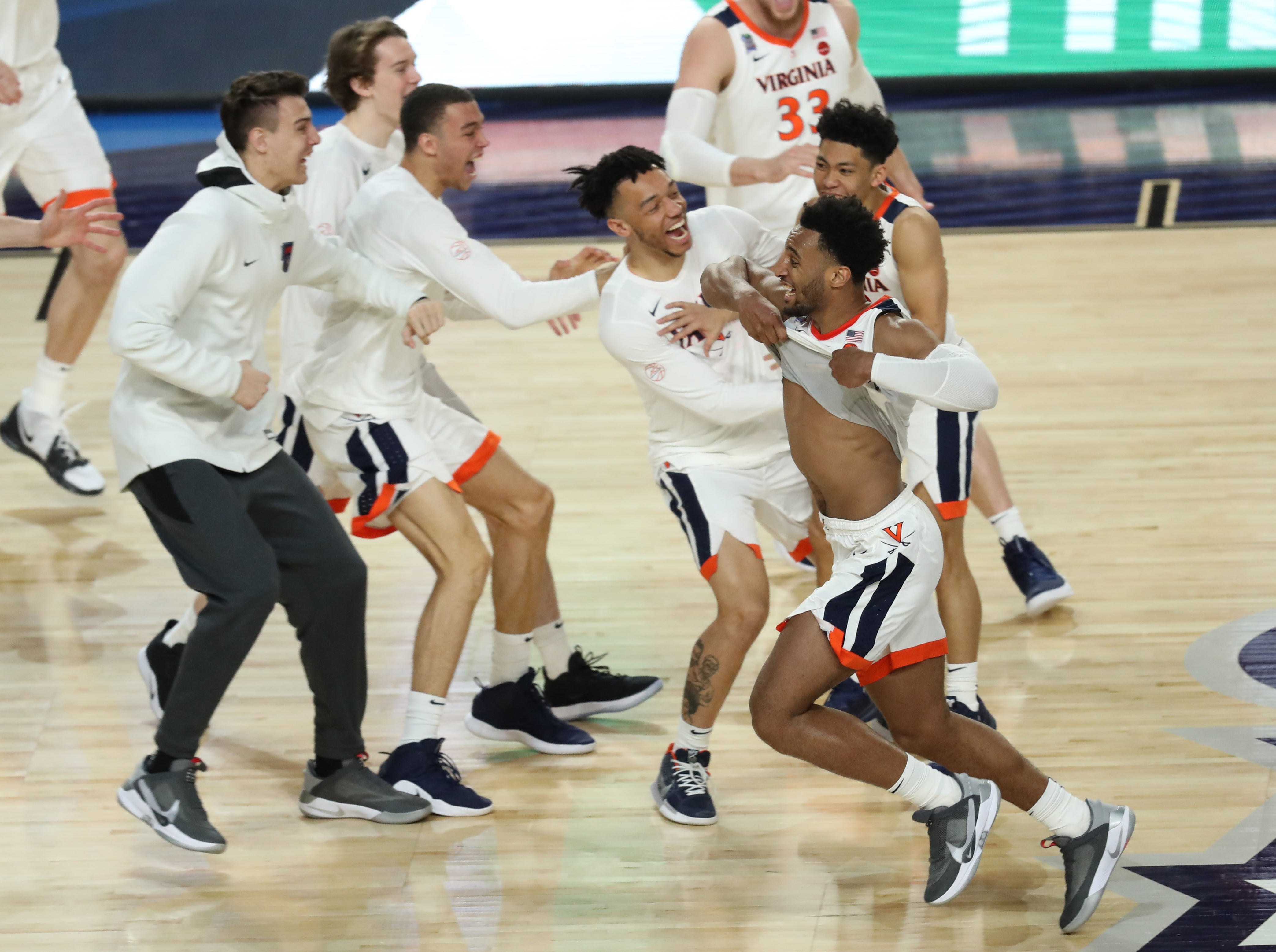 Apr 8, 2019; Minneapolis, MN, USA; Virginia Cavaliers guard Braxton Key (2) and teammates celebrate after defeating the Texas Tech Red Raiders in the championship game of the 2019 men's Final Four at US Bank Stadium. Mandatory Credit: Brace Hemmelgarn-USA TODAY Sports