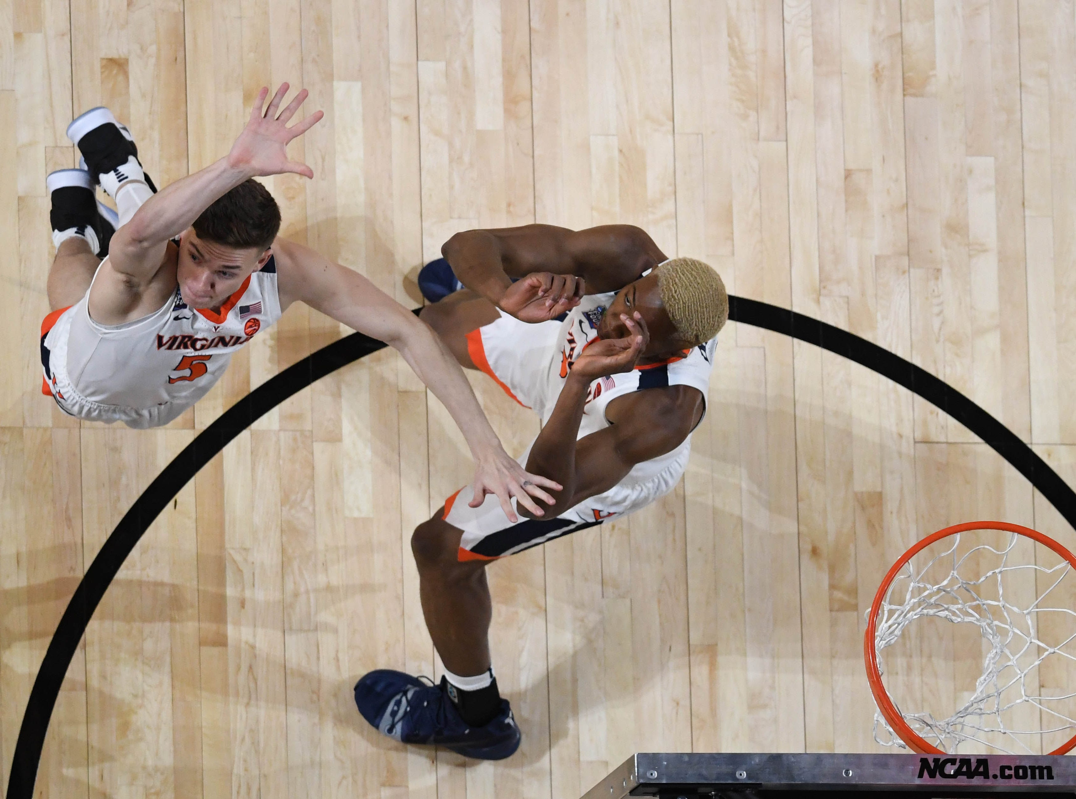 Apr 8, 2019; Minneapolis, MN, USA; Virginia Cavaliers guard Kyle Guy (5) and forward Mamadi Diakite (25) defend the net against the Texas Tech Red Raiders in the first half in the championship game of the 2019 men's Final Four at US Bank Stadium. Mandatory Credit: Robert Deutsch-USA TODAY Sports