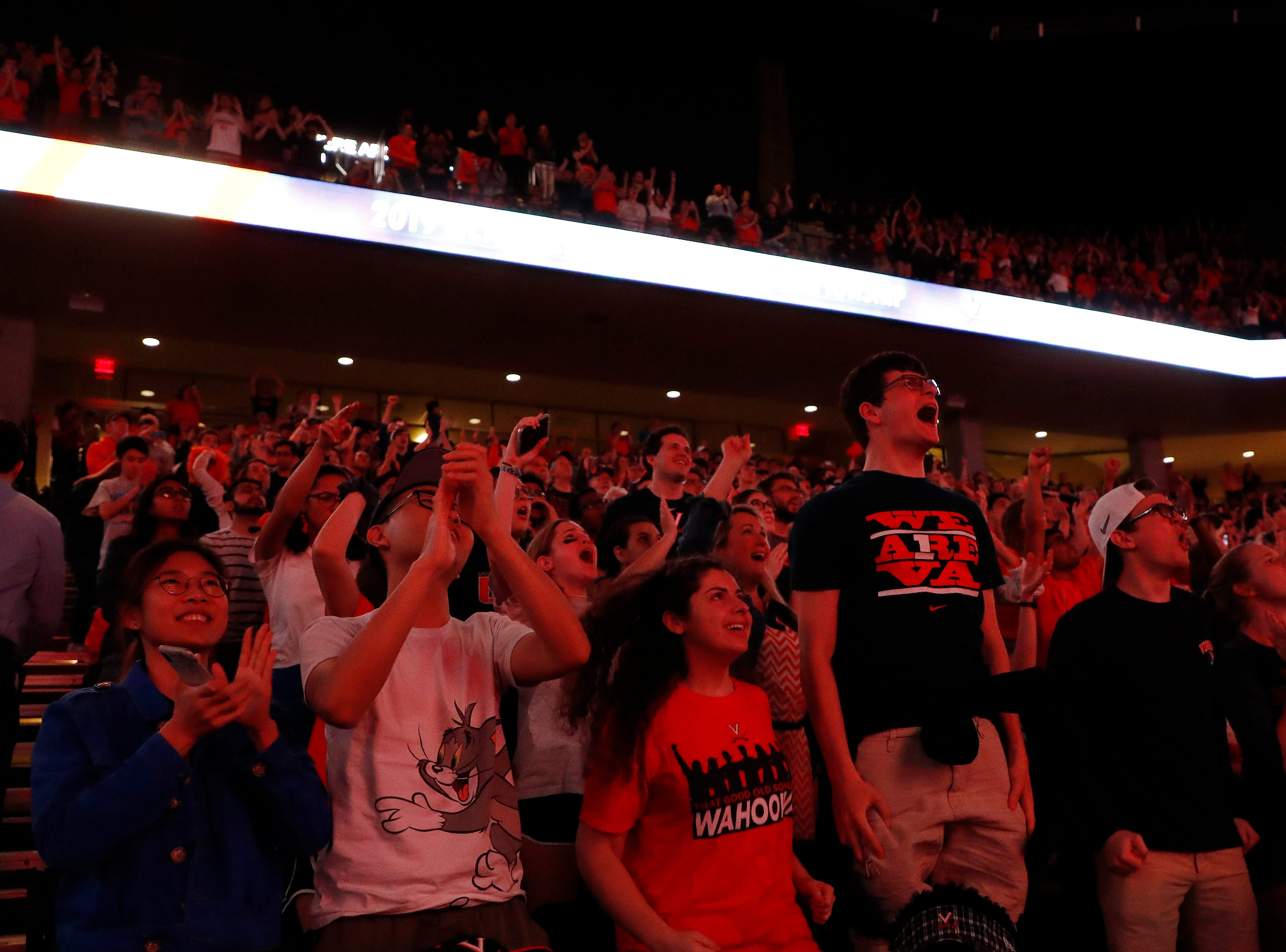 Apr 8, 2019; Charlottesville, VA, USA; Fans cheer during a viewing party at John Paul Jones Arena for the the championship game of the 2019 men's Final Four between the Texas Tech Red Raiders and the Virginia Cavaliers. Mandatory Credit: Geoff Burke-USA TODAY Sports