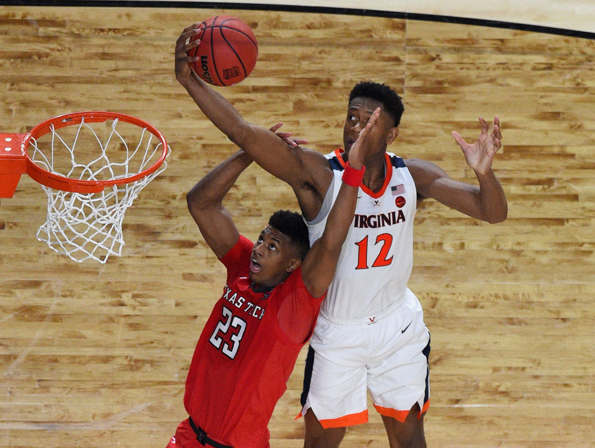 Apr 8, 2019; Minneapolis, MN, USA; Virginia Cavaliers guard De'Andre Hunter (12) reaches for the ball over Texas Tech Red Raiders guard Jarrett Culver (23) in overtime in the championship game of the 2019 men's Final Four at US Bank Stadium. Mandatory Credit: Robert Deutsch-USA TODAY Sports