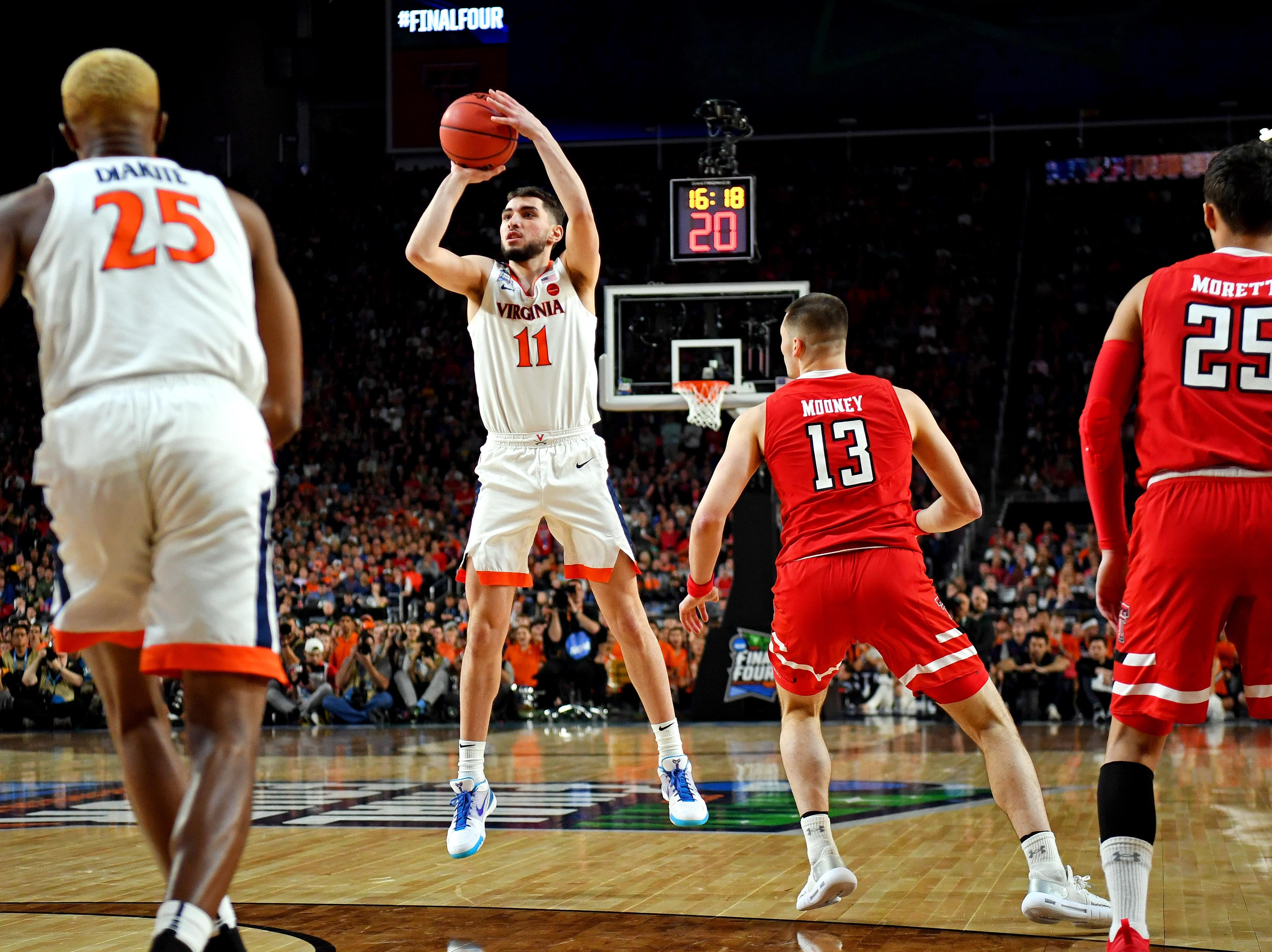Apr 8, 2019; Minneapolis, MN, USA; Virginia Cavaliers guard Ty Jerome (11) shoots the ball against Texas Tech Red Raiders guard Matt Mooney (13) during the first half in the championship game of the 2019 men's Final Four at US Bank Stadium. Mandatory Credit: Bob Donnan-USA TODAY Sports