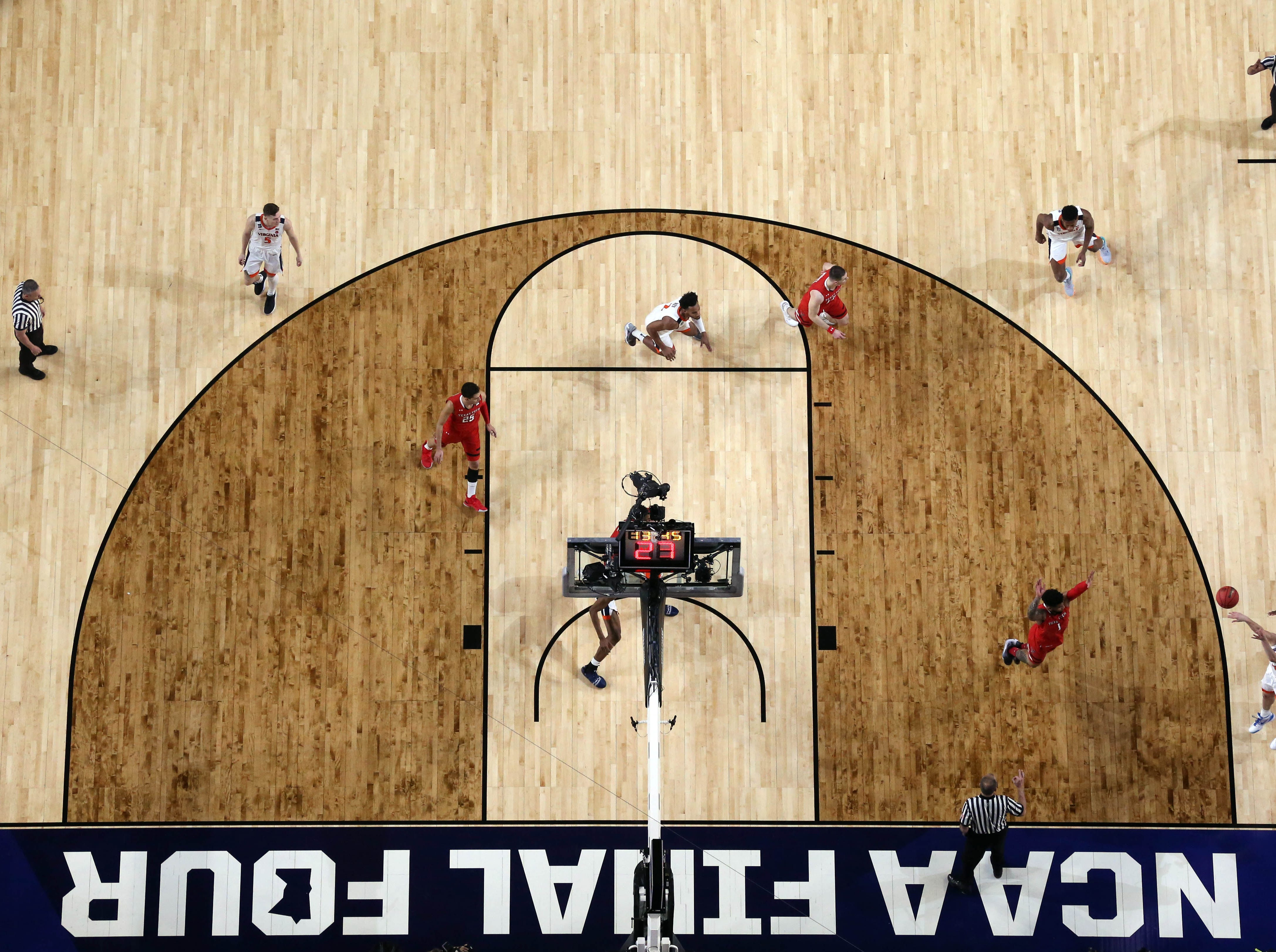 Apr 8, 2019; Minneapolis, MN, USA; A general view as Virginia Cavaliers guard Ty Jerome (11) shoots a three-pointer during the first half against the Texas Tech Red Raiders in the championship game of the 2019 men's Final Four at US Bank Stadium. Mandatory Credit: Bob Donnan-USA TODAY Sports