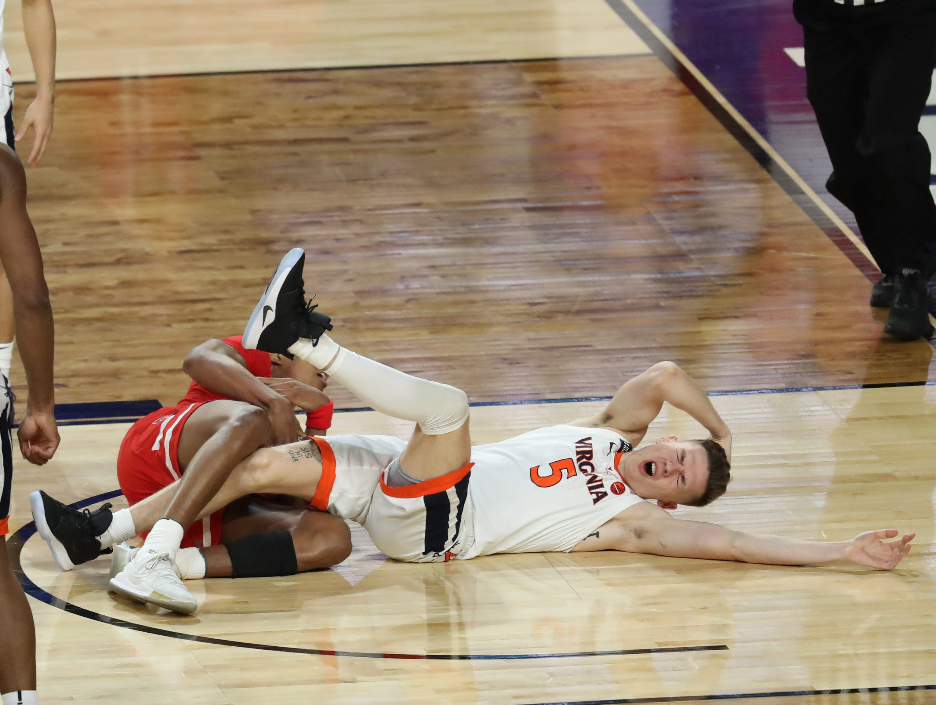 Apr 8, 2019; Minneapolis, MN, USA; Texas Tech Red Raiders guard Jarrett Culver (23) and Virginia Cavaliers guard Kyle Guy (5) fall to the ground during the second half in the championship game of the 2019 men's Final Four at US Bank Stadium. Mandatory Credit: Brace Hemmelgarn-USA TODAY Sports