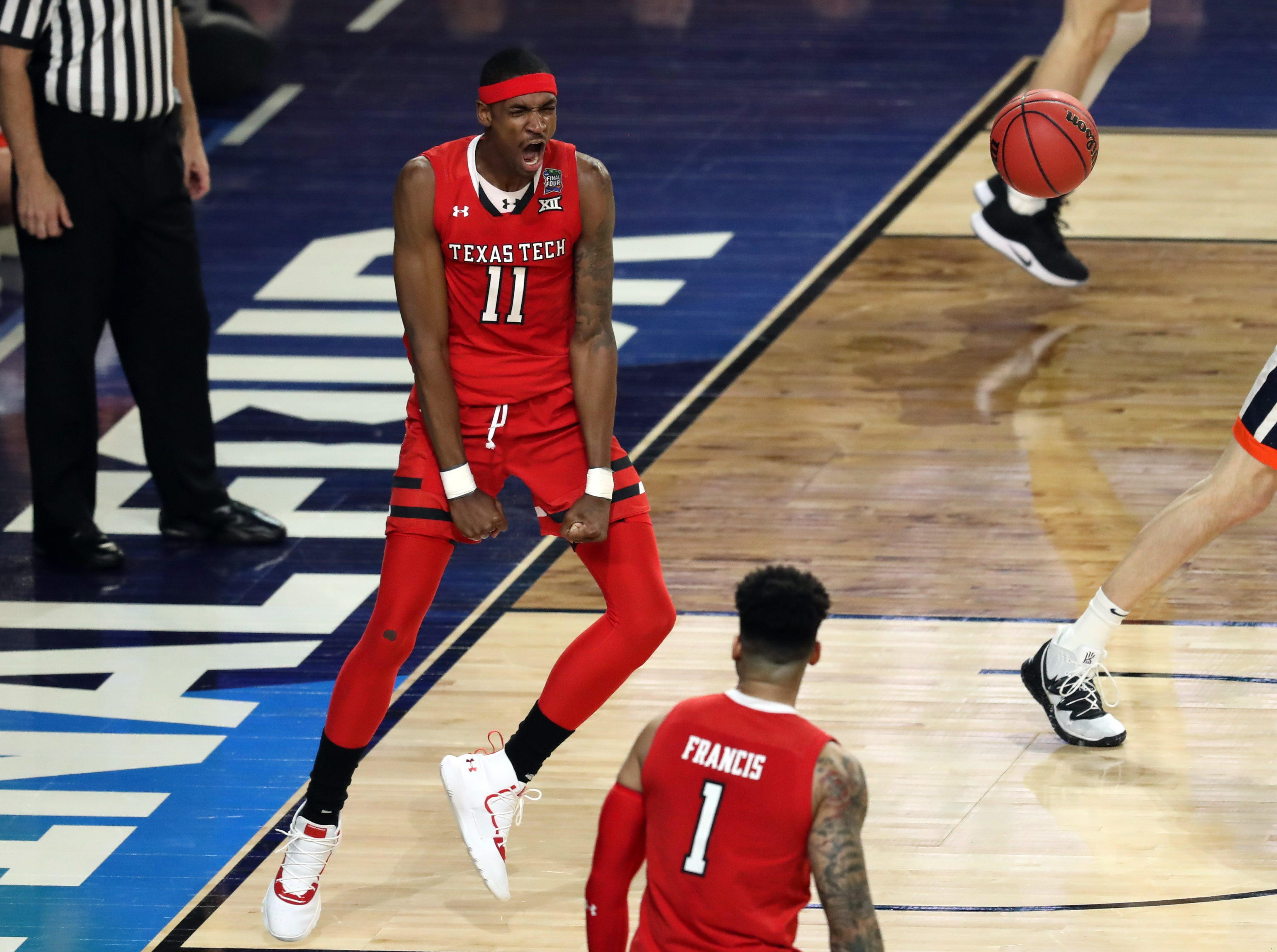 Apr 8, 2019; Minneapolis, MN, USA; Texas Tech Red Raiders forward Tariq Owens (11) celebrates after dunking the ball against the Virginia Cavaliers in the championship game of the 2019 men's Final Four at US Bank Stadium. Mandatory Credit: Brace Hemmelgarn-USA TODAY Sports