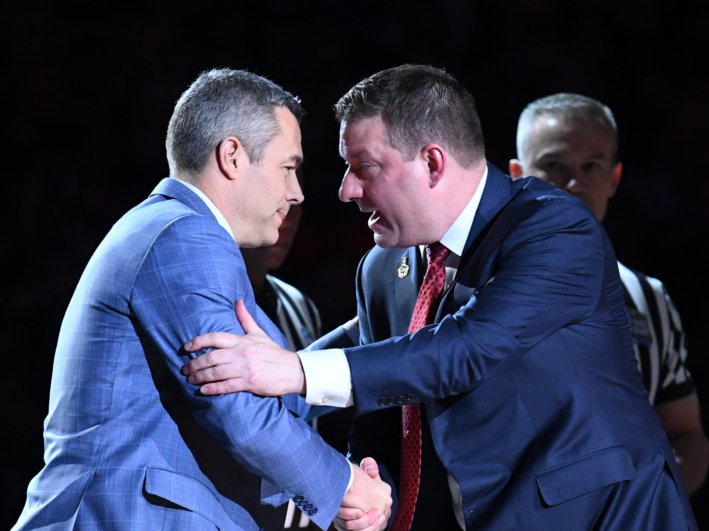 Apr 8, 2019; Minneapolis, MN, USA; Virginia Cavaliers head coach Tony Bennett (left) and Texas Tech Red Raiders head coach Chris Beard (right) shake hands prior to the start of the championship game of the 2019 men's Final Four at US Bank Stadium. Mandatory Credit: Robert Deutsch-USA TODAY Sports