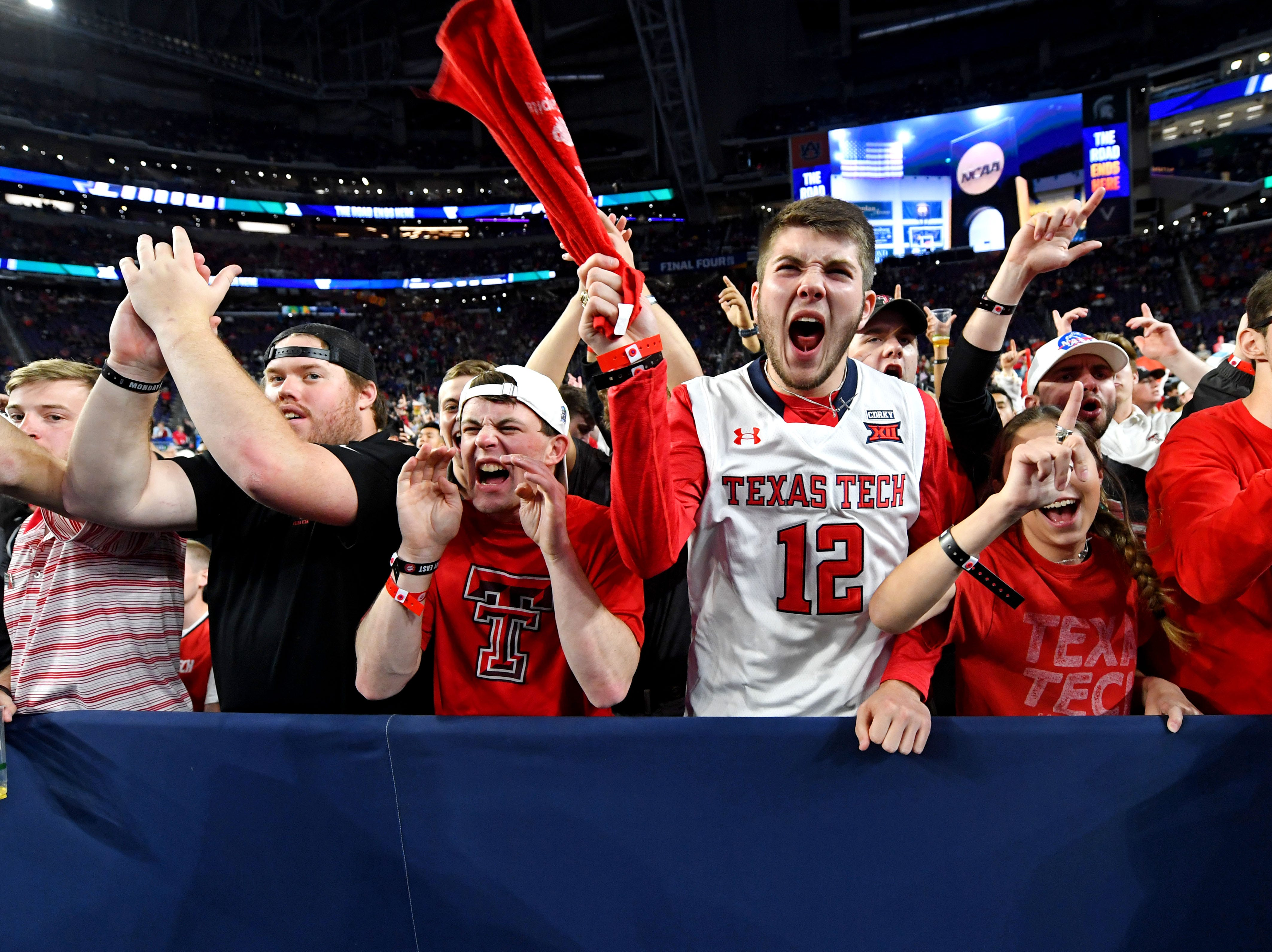 Apr 8, 2019; Minneapolis, MN, USA; Texas Tech Red Raiders fans cheers before the game against the Virginia Cavaliers in the championship game of the 2019 men's Final Four at US Bank Stadium. Mandatory Credit: Bob Donnan-USA TODAY Sports