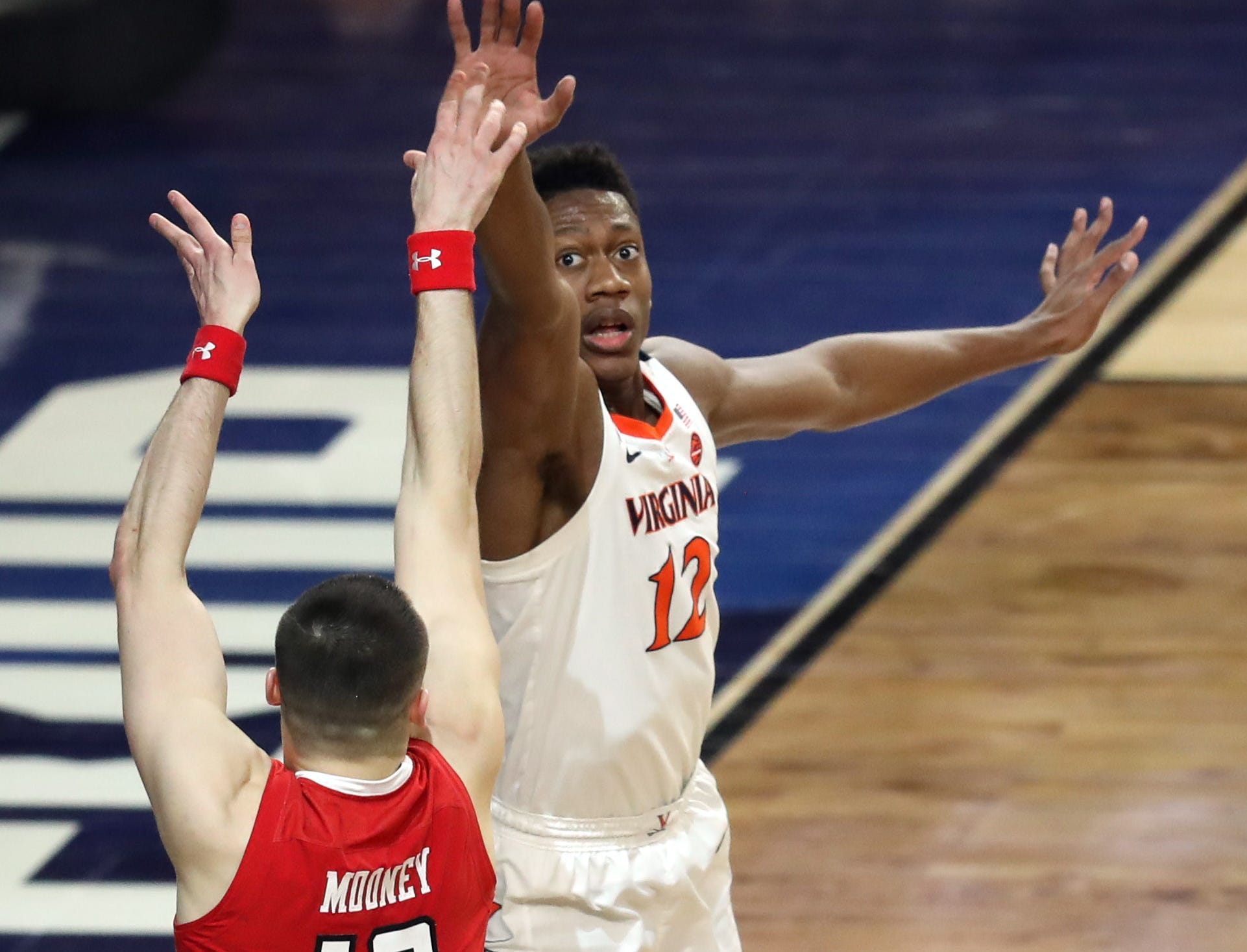 Apr 8, 2019; Minneapolis, MN, USA; Texas Tech Red Raiders guard Matt Mooney (13) shoots over Virginia Cavaliers guard De'Andre Hunter (12) during the first half in the championship game of the 2019 men's Final Four at US Bank Stadium. Mandatory Credit: Brace Hemmelgarn-USA TODAY Sports