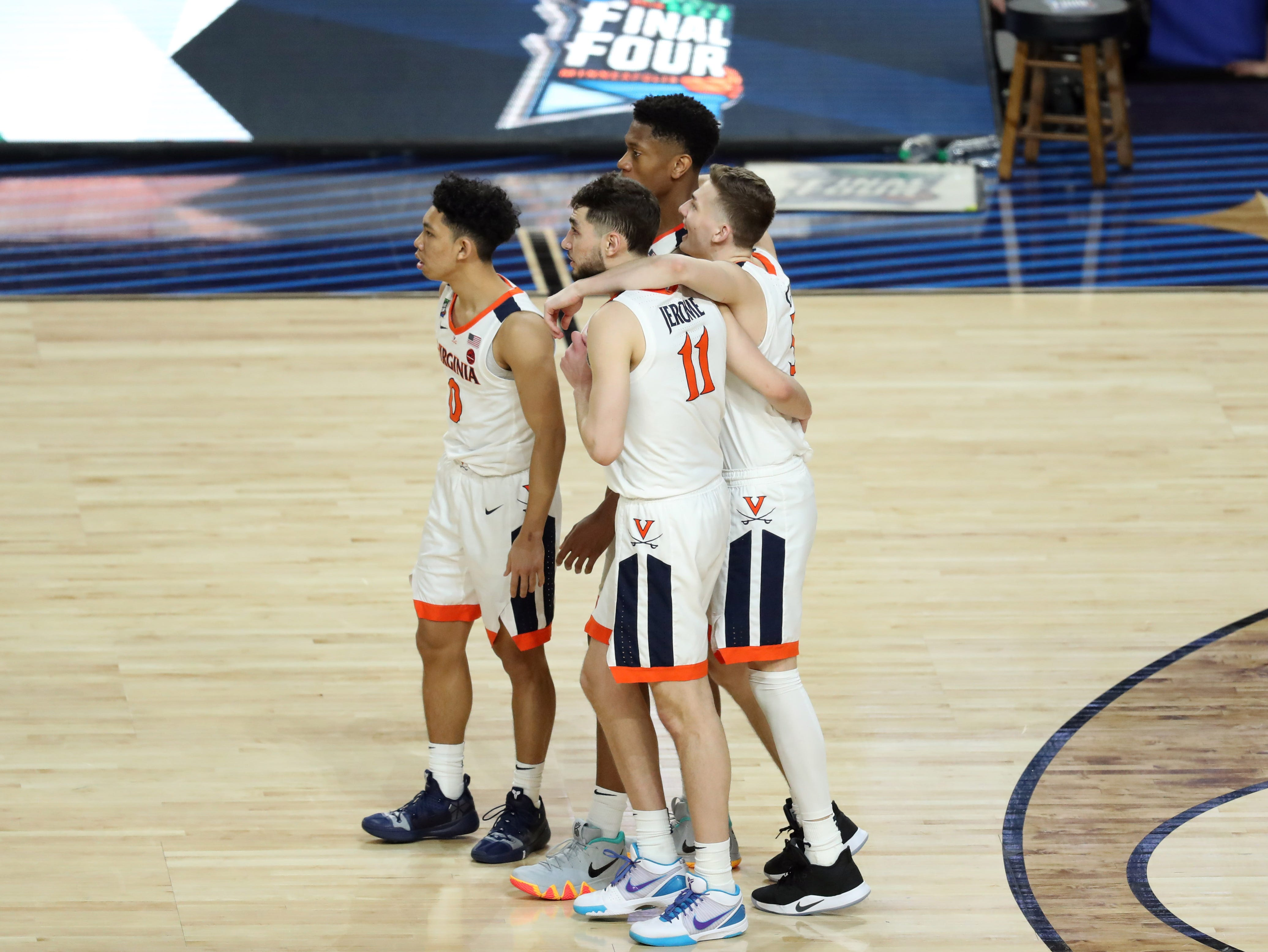 Apr 8, 2019; Minneapolis, MN, USA; Virginia Cavaliers guard Ty Jerome (11) and guard Kyle Guy (5) and teammates embrace during the second half against the Texas Tech Red Raiders in the championship game of the 2019 men's Final Four at US Bank Stadium. Mandatory Credit: Brace Hemmelgarn-USA TODAY Sports
