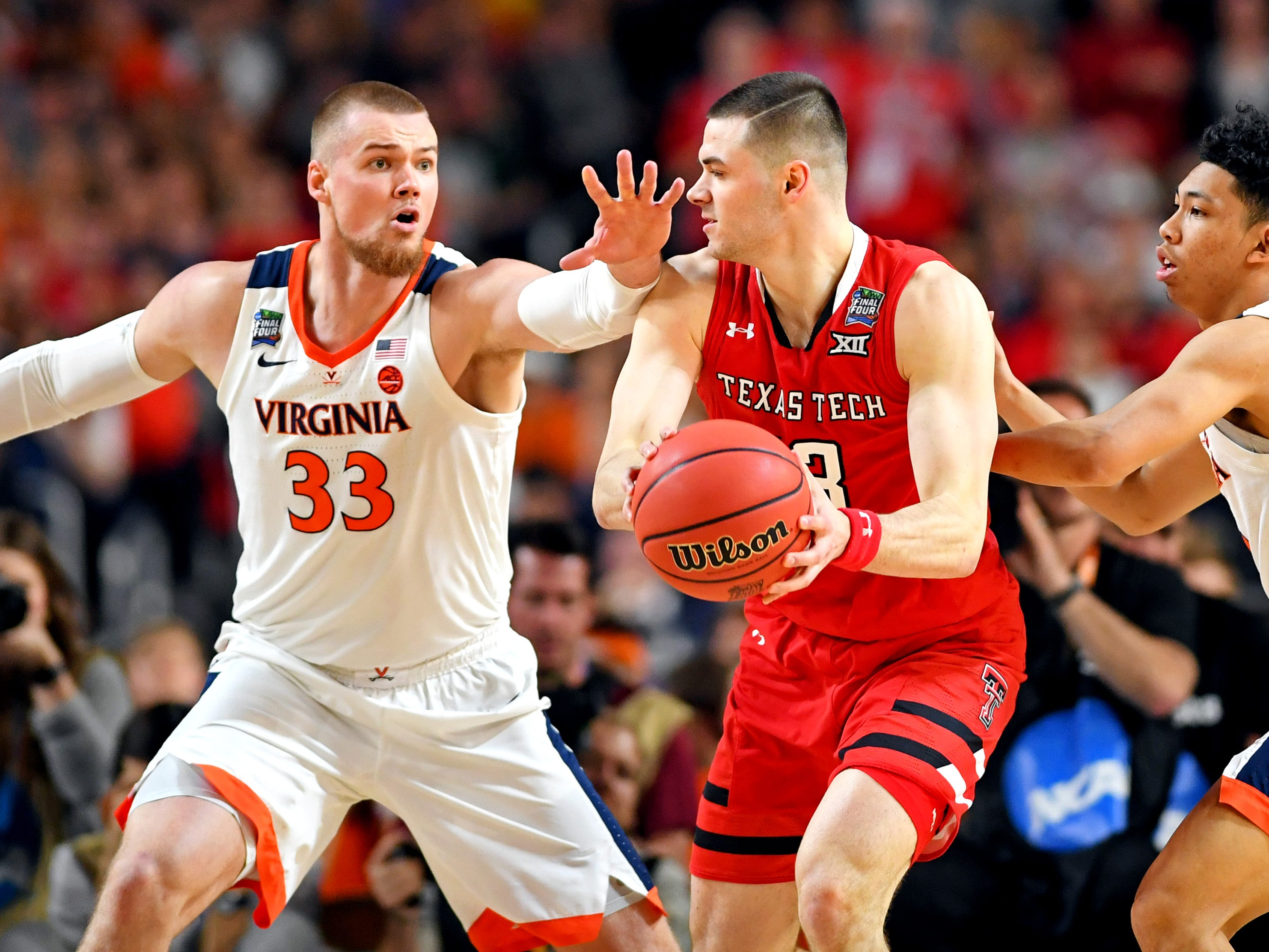 Apr 8, 2019; Minneapolis, MN, USA; Texas Tech Red Raiders guard Matt Mooney (13) handles the ball against Virginia Cavaliers center Jack Salt (33) and guard Kihei Clark (0) during the first half in the championship game of the 2019 men's Final Four at US Bank Stadium. Mandatory Credit: Bob Donnan-USA TODAY Sports