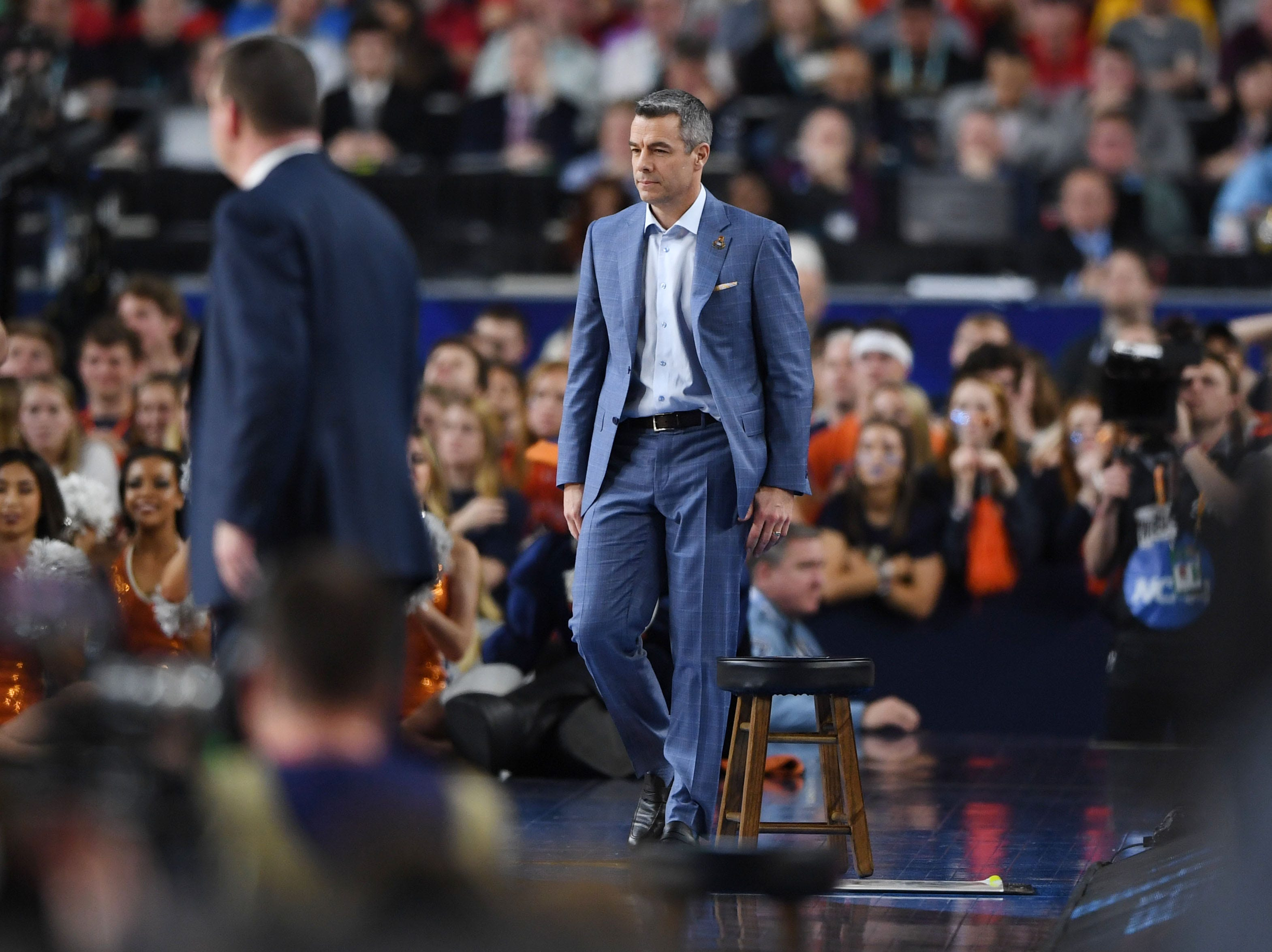 Apr 8, 2019; Minneapolis, MN, USA; Texas Tech Red Raiders head coach Chris Beard (left) and Virginia Cavaliers head coach Tony Bennett (right) in the championship game of the 2019 men's Final Four at US Bank Stadium. Mandatory Credit: Shanna Lockwood-USA TODAY Sports