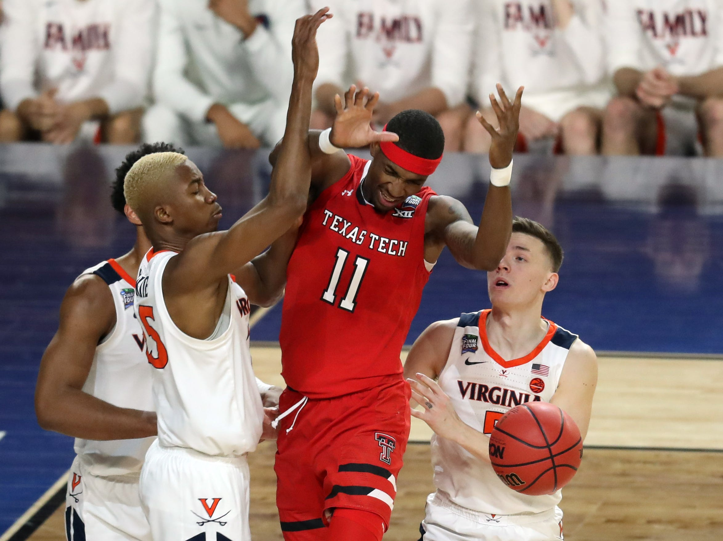 Apr 8, 2019; Minneapolis, MN, USA; Texas Tech Red Raiders forward Tariq Owens (11) loses control over the ball while Virginia Cavaliers forward Mamadi Diakite (25) and guard Kyle Guy (5) defend during the first half in the championship game of the 2019 men's Final Four at US Bank Stadium. Mandatory Credit: Brace Hemmelgarn-USA TODAY Sports