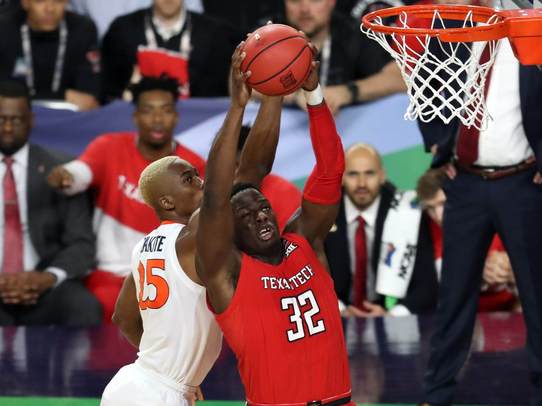 Apr 8, 2019; Minneapolis, MN, USA; Virginia Cavaliers forward Mamadi Diakite (25) blocks the shot of Texas Tech Red Raiders center Norense Odiase (32) during the first half in the championship game of the 2019 men's Final Four at US Bank Stadium. Mandatory Credit: Brace Hemmelgarn-USA TODAY Sports