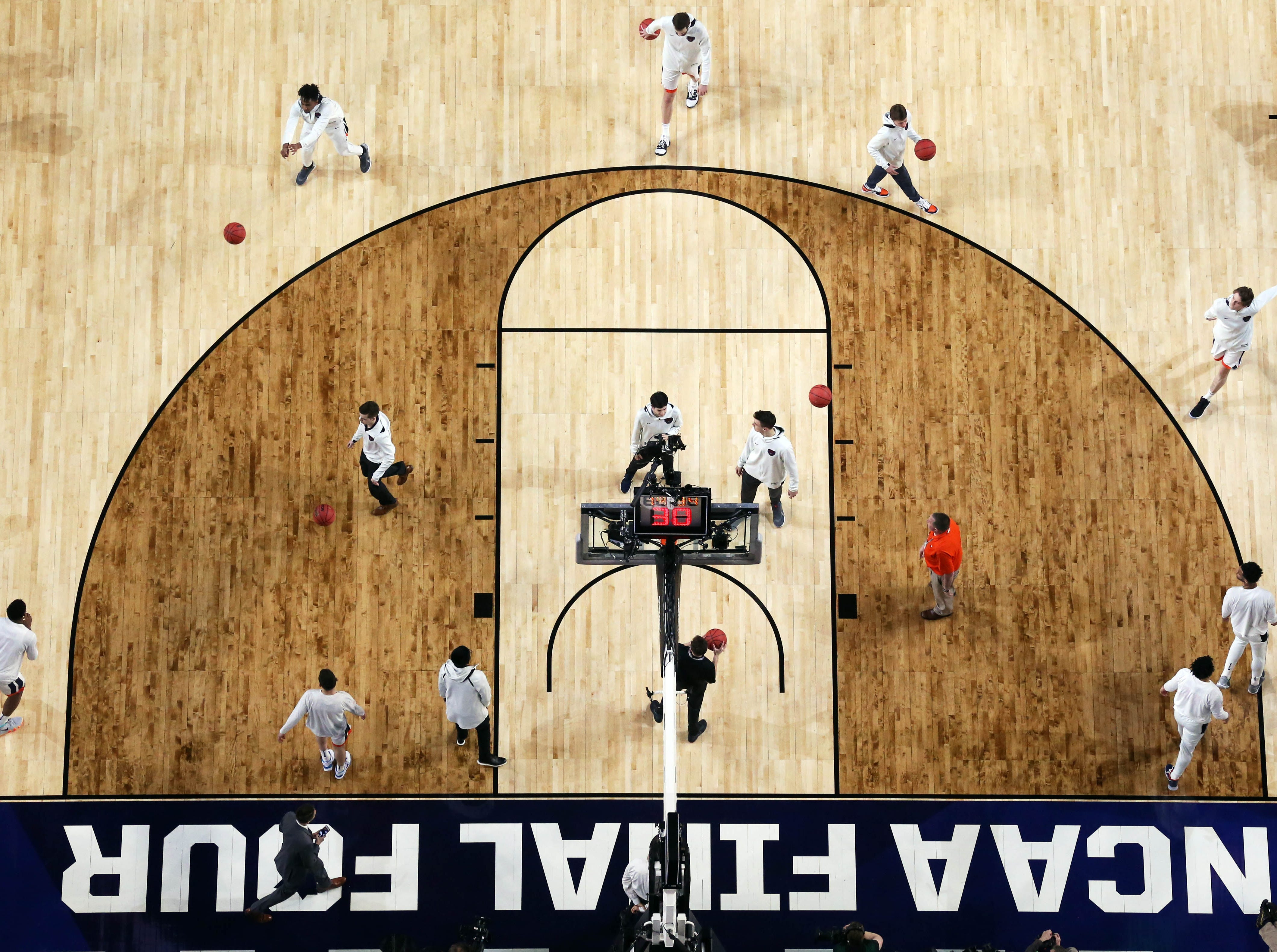 Apr 8, 2019; Minneapolis, MN, USA; The Virginia Cavaliers men's basketball team warms up prior to the start of the championship game of the 2019 men's Final Four against the Texas Tech Red Raiders at US Bank Stadium. Mandatory Credit: Bob Donnan-USA TODAY Sports
