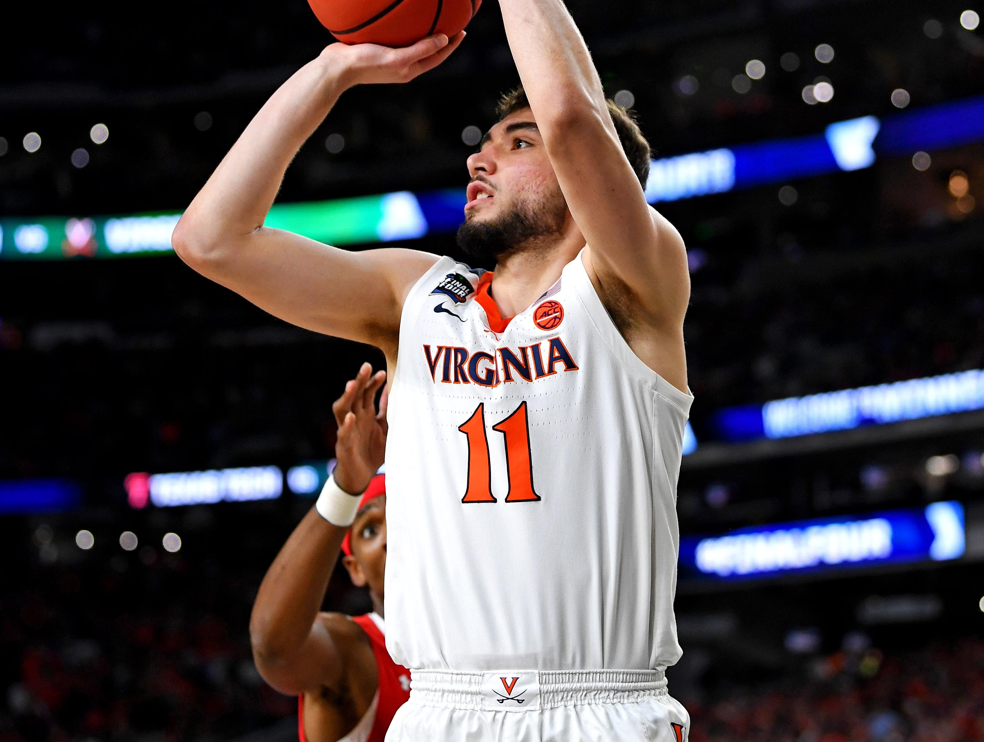 Apr 8, 2019; Minneapolis, MN, USA; Virginia Cavaliers guard Ty Jerome (11) shoots the ball against Texas Tech Red Raiders forward Tariq Owens (11) during the second half in the championship game of the 2019 men's Final Four at US Bank Stadium. Mandatory Credit: Bob Donnan-USA TODAY Sports