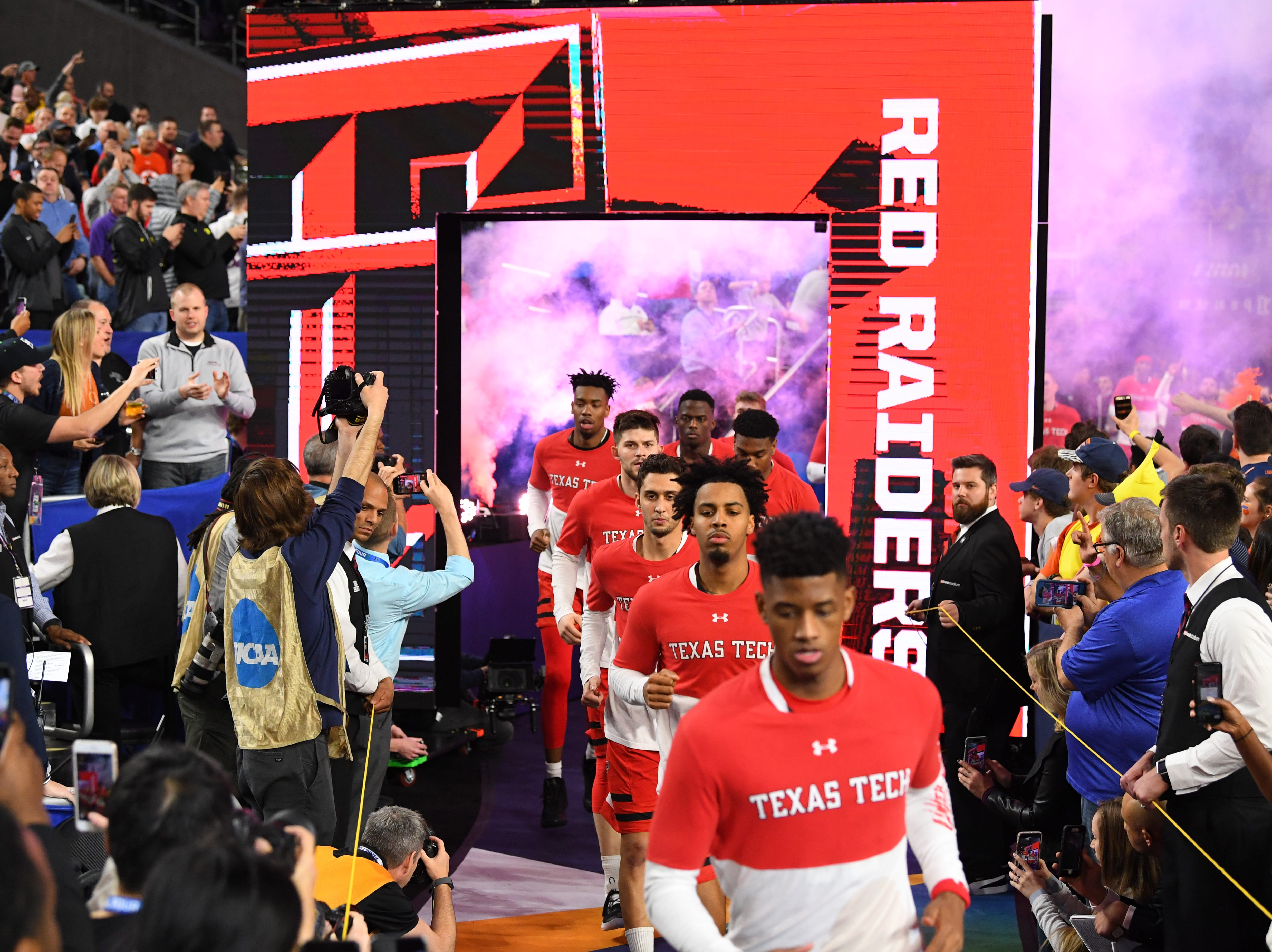 Apr 8, 2019; Minneapolis, MN, USA; Texas Tech Red Raiders take the floor prior to facing the Virginia Cavaliers in the championship game of the 2019 men's Final Four at US Bank Stadium. Mandatory Credit: Robert Deutsch-USA TODAY Sports