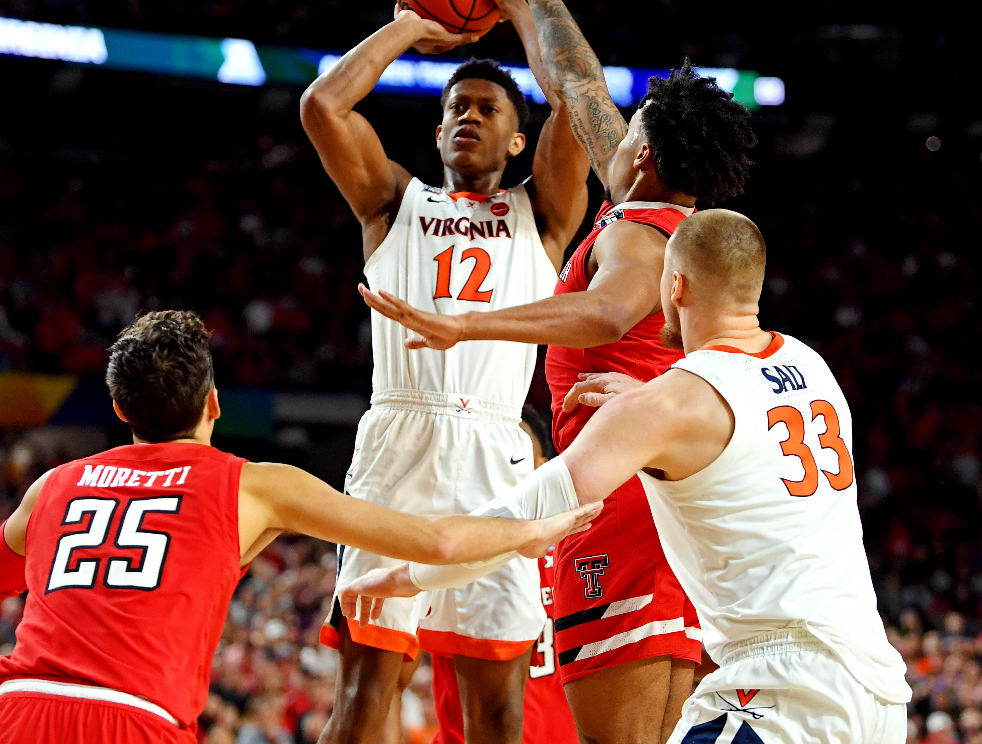 Apr 8, 2019; Minneapolis, MN, USA; Virginia Cavaliers guard De'Andre Hunter (12) shoots the ball against Texas Tech Red Raiders guard Kyler Edwards (0) during the first half in the championship game of the 2019 men's Final Four at US Bank Stadium. Mandatory Credit: Bob Donnan-USA TODAY Sports
