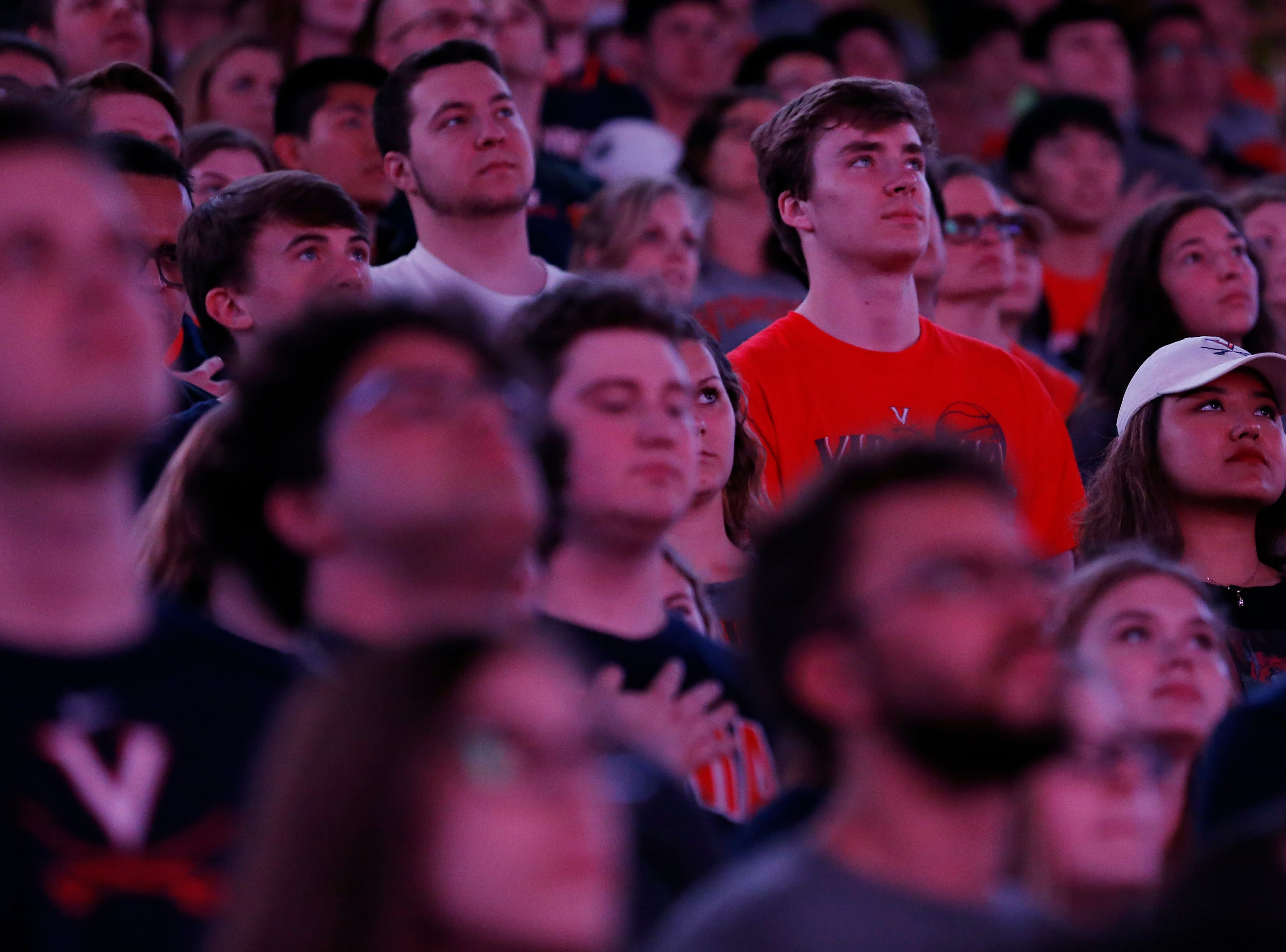 Apr 8, 2019; Charlottesville, VA, USA; Fans look on during a viewing party at John Paul Jones Arena for the the championship game of the 2019 men's Final Four between the Texas Tech Red Raiders and the Virginia Cavaliers. Mandatory Credit: Geoff Burke-USA TODAY Sports