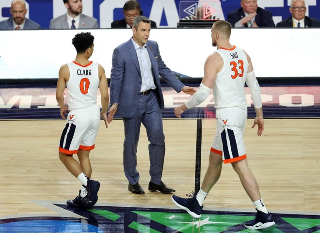Apr 8, 2019; Minneapolis, MN, USA; Virginia Cavaliers head coach Tony Bennett high fives guard Kihei Clark (0) and center Jack Salt (33) during the first half against the Texas Tech Red Raiders in the championship game of the 2019 men's Final Four at US Bank Stadium. Mandatory Credit: Brace Hemmelgarn-USA TODAY Sports
