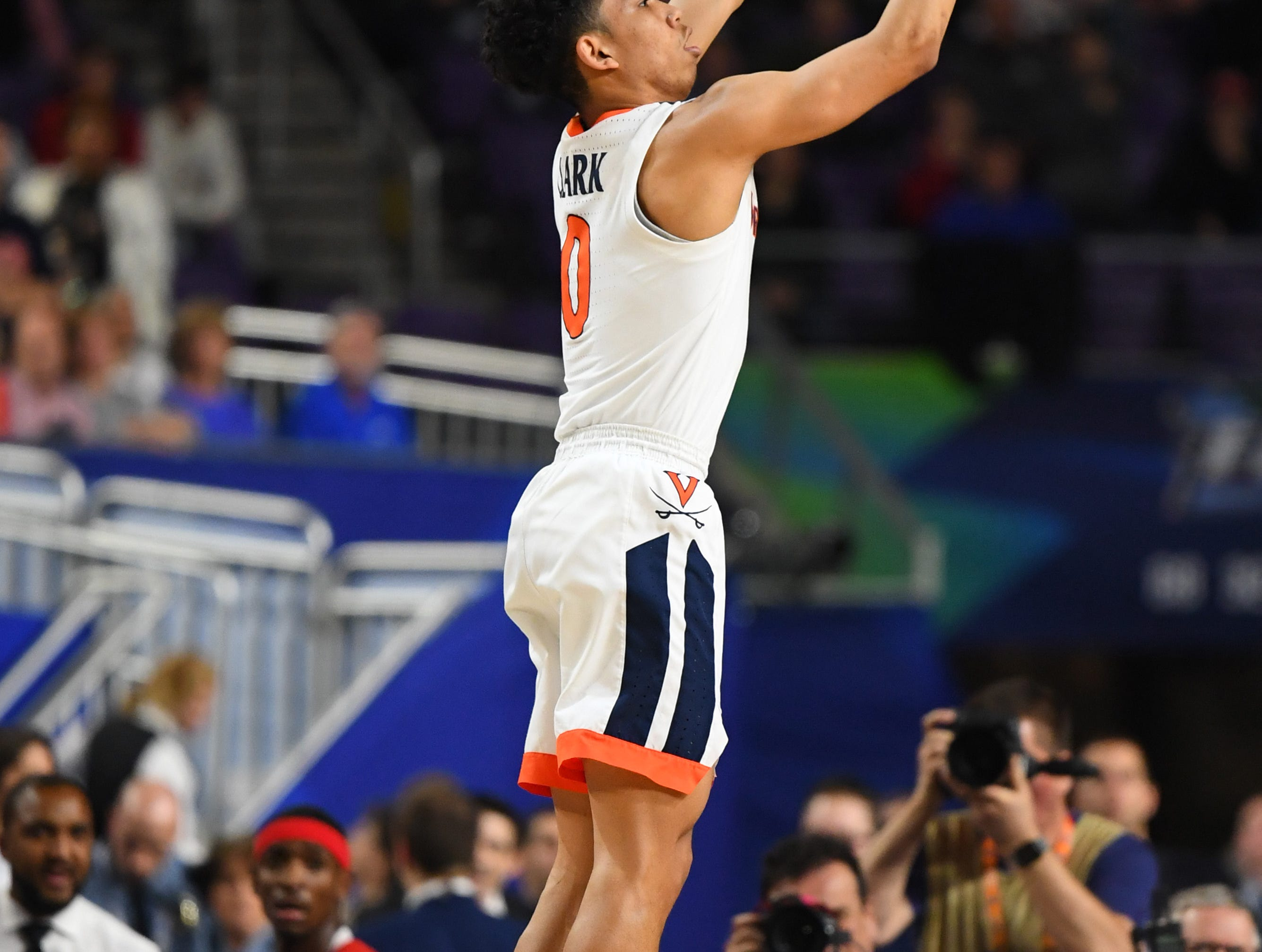 Apr 8, 2019; Minneapolis, MN, USA; Virginia Cavaliers guard Kihei Clark (0) hits a three-point shot against the Texas Tech Red Raiders in the championship game of the 2019 men's Final Four at US Bank Stadium. Mandatory Credit: Robert Deutsch-USA TODAY Sports