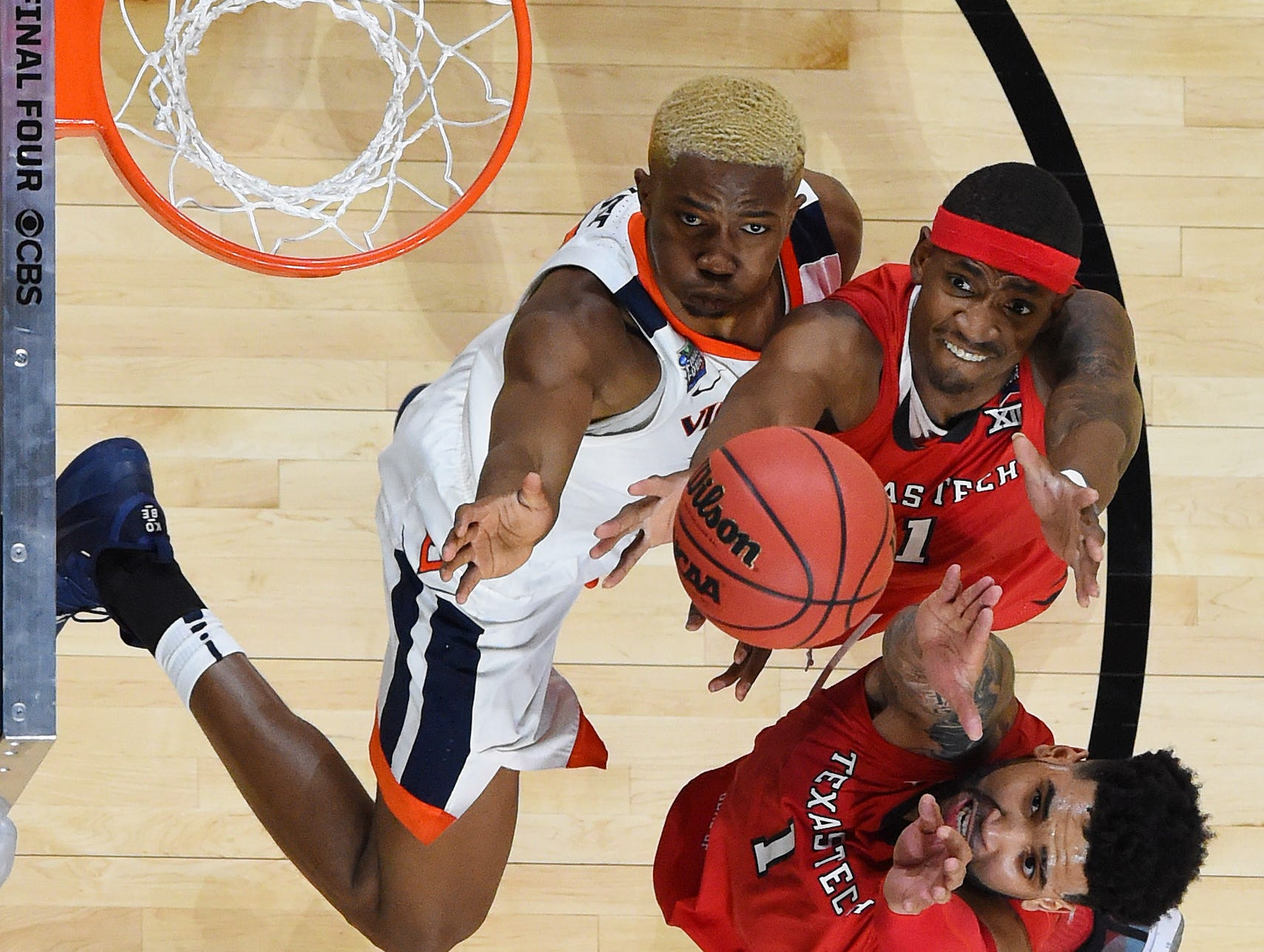Apr 8, 2019; Minneapolis, MN, USA; Virginia Cavaliers forward Mamadi Diakite (25) and Texas Tech Red Raiders forward Tariq Owens (11) and guard Brandone Francis (1) go up for a rebound during the first half in the championship game of the 2019 men's Final Four at US Bank Stadium. Mandatory Credit: Bob Donnan-USA TODAY Sports
