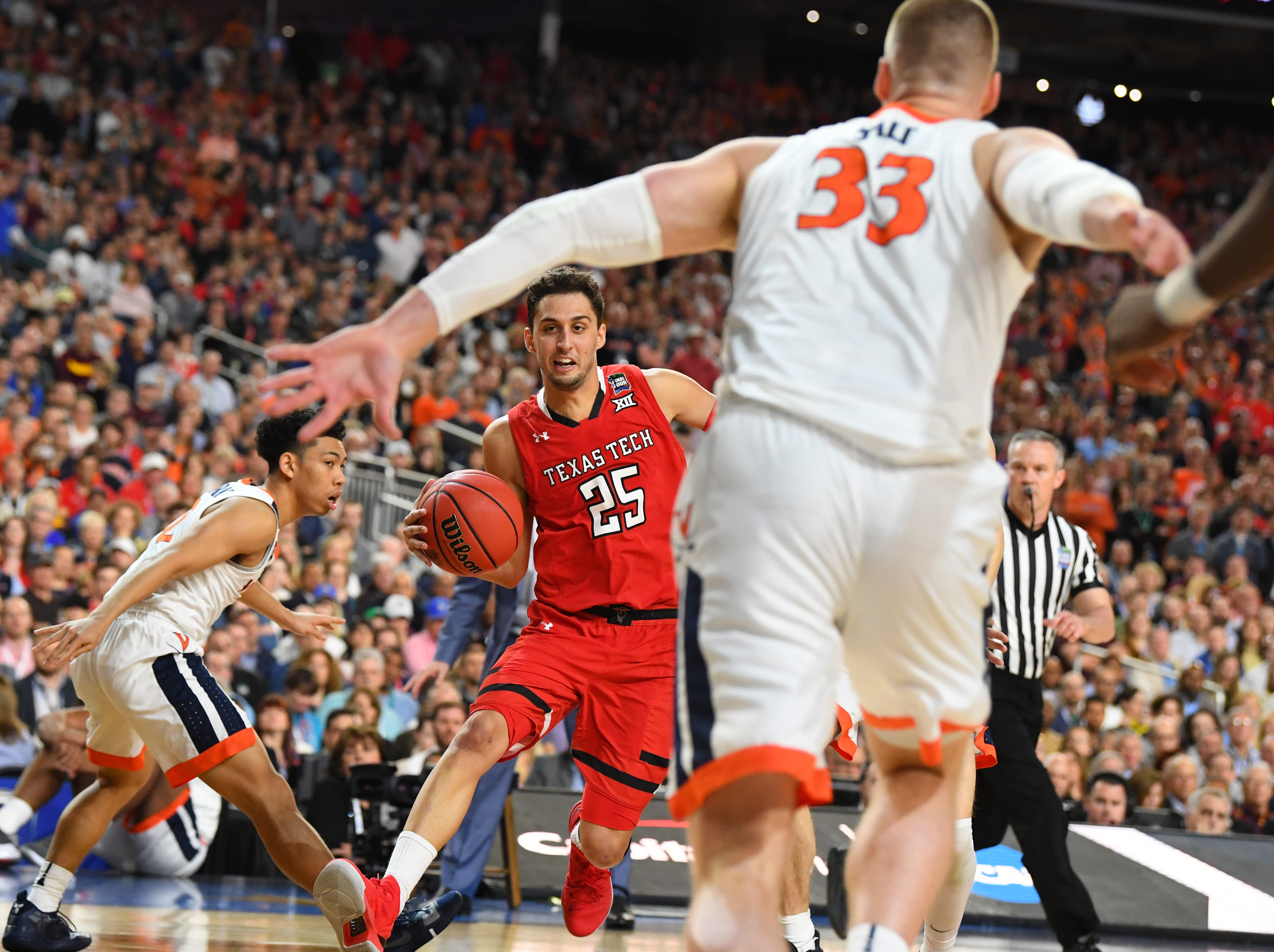 Apr 8, 2019; Minneapolis, MN, USA; Texas Tech Red Raiders guard Davide Moretti (25) drives to the basket defended by Virginia Cavaliers center Jack Salt (33) in the championship game of the 2019 men's Final Four at US Bank Stadium. Mandatory Credit: Robert Deutsch-USA TODAY Sports
