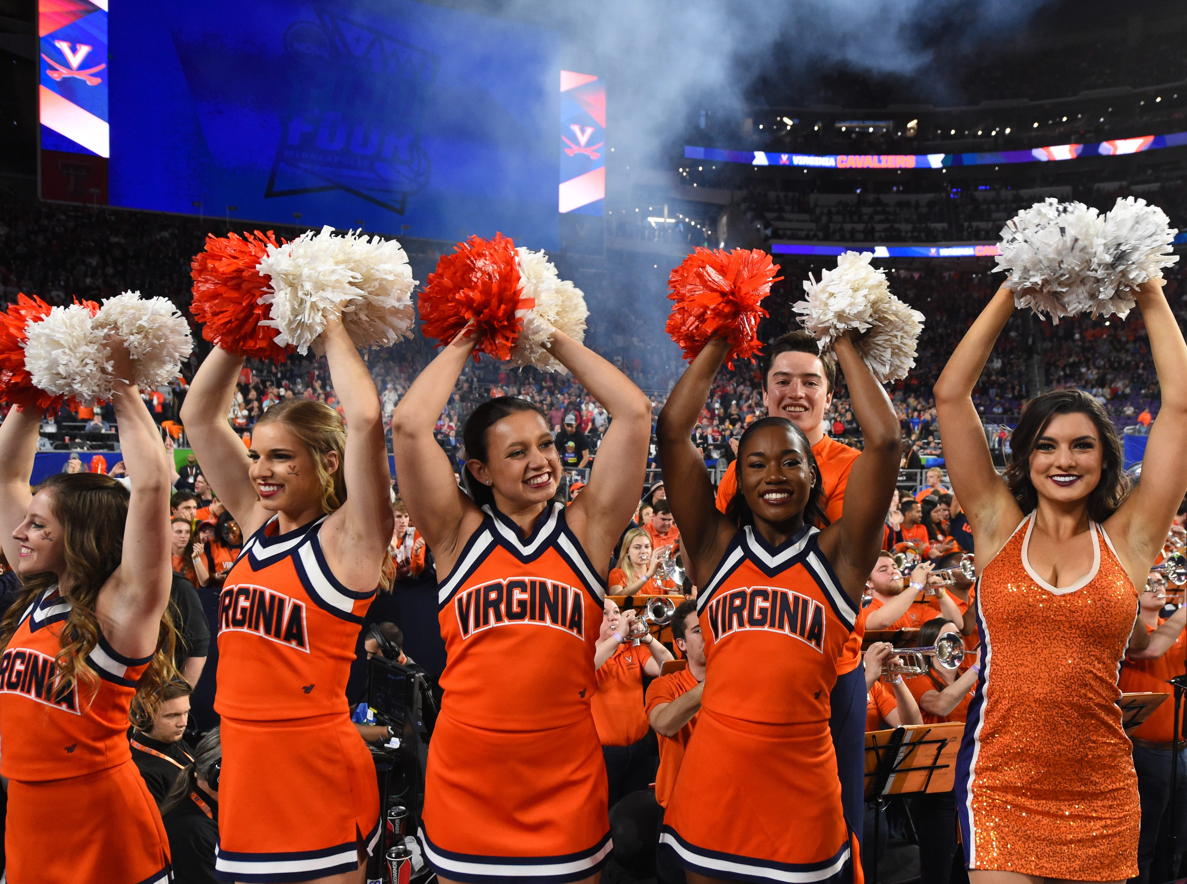 Apr 8, 2019; Minneapolis, MN, USA; Virginia Cavaliers cheerleaders prior to facing the Texas Tech Red Raiders in the championship game of the 2019 men's Final Four at US Bank Stadium. Mandatory Credit: Robert Deutsch-USA TODAY Sports