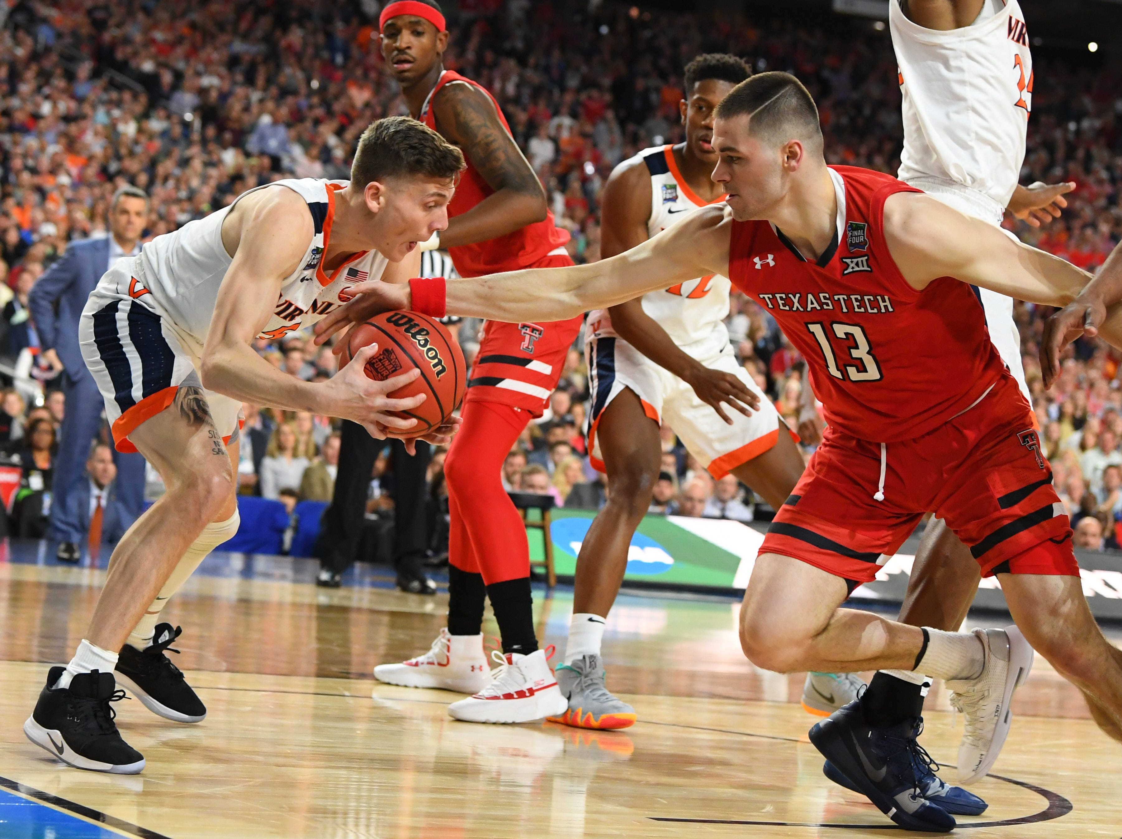 Apr 8, 2019; Minneapolis, MN, USA; Virginia Cavaliers guard Kyle Guy (5) steals the ball from Texas Tech Red Raiders guard Matt Mooney (13) in the championship game of the 2019 men's Final Four at US Bank Stadium. Mandatory Credit: Robert Deutsch-USA TODAY Sports