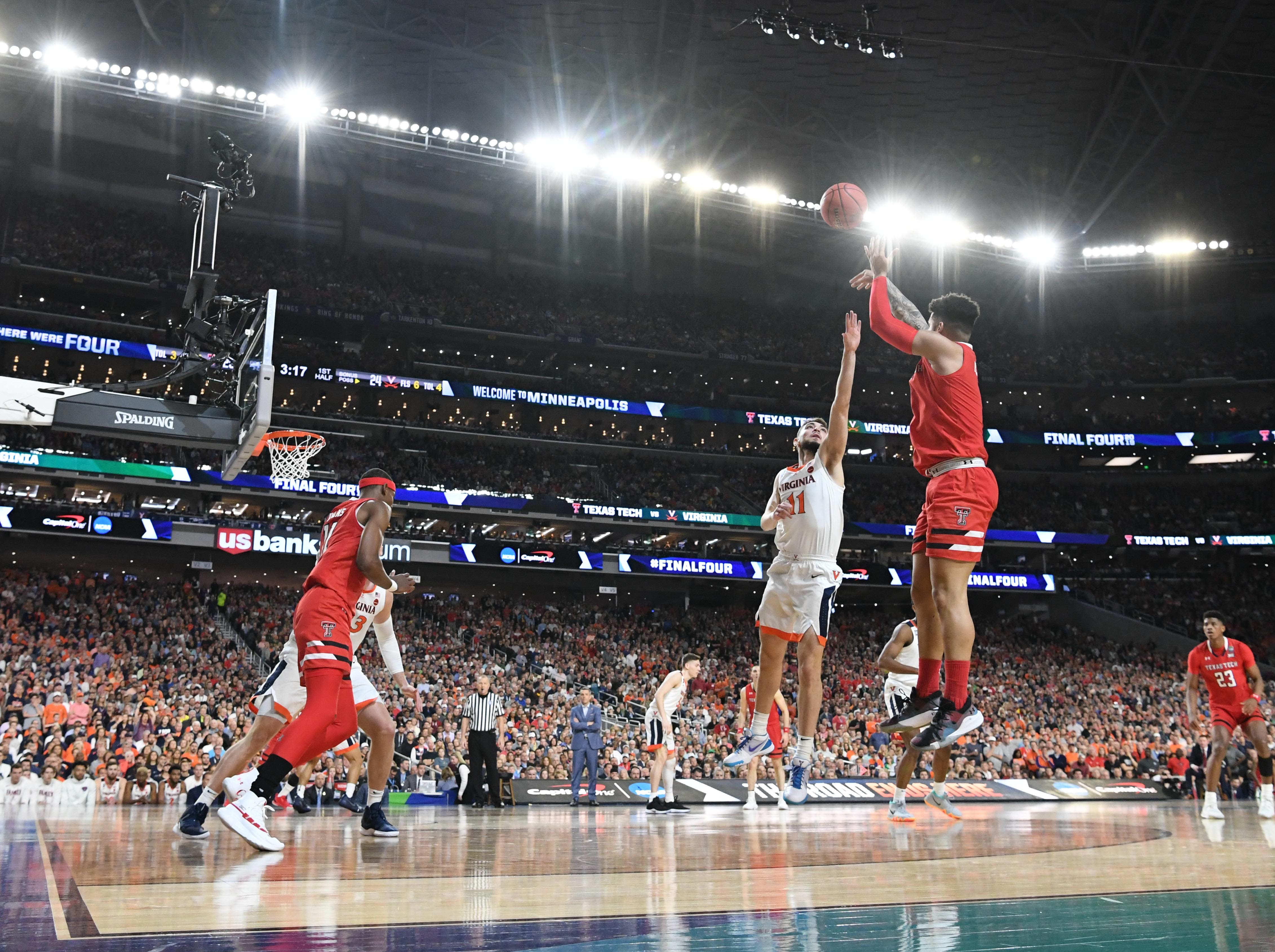 Apr 8, 2019; Minneapolis, MN, USA; Texas Tech Red Raiders guard Brandone Francis (1) shoots over Virginia Cavaliers guard Ty Jerome (11) in the first half in the championship game of the 2019 men's Final Four at US Bank Stadium. Mandatory Credit: Robert Deutsch-USA TODAY Sports
