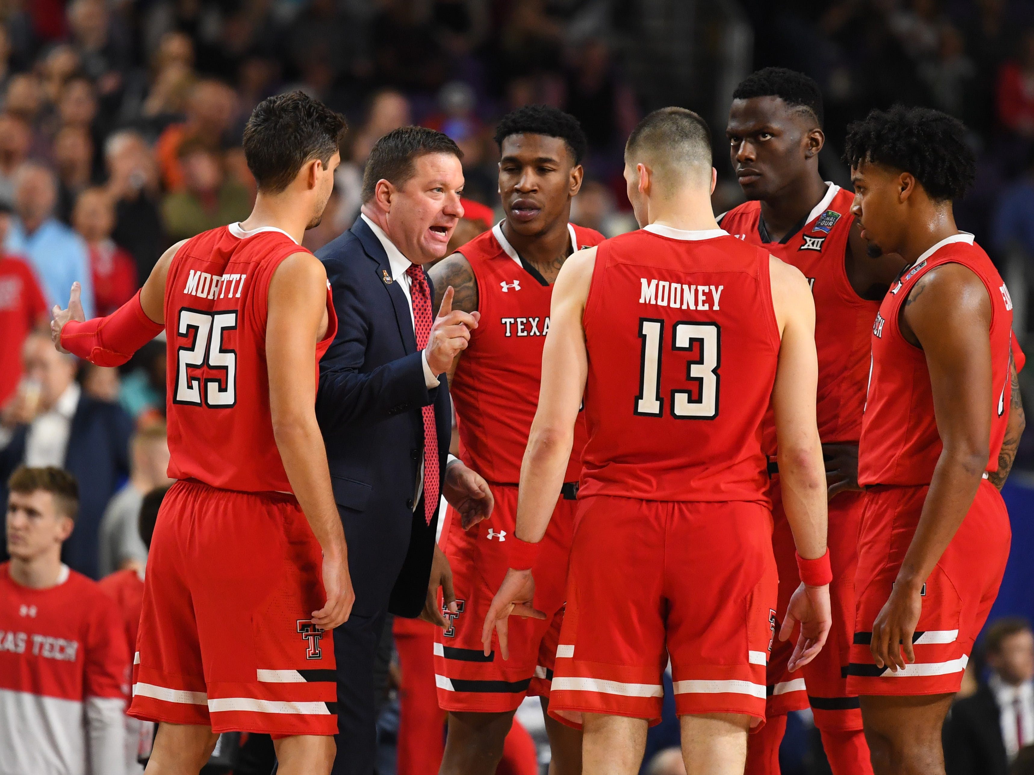 Apr 8, 2019; Minneapolis, MN, USA; Texas Tech Red Raiders head coach Chris Beard huddles with his team against the Virginia Cavaliers in the championship game of the 2019 men's Final Four at US Bank Stadium. Mandatory Credit: Robert Deutsch-USA TODAY Sports