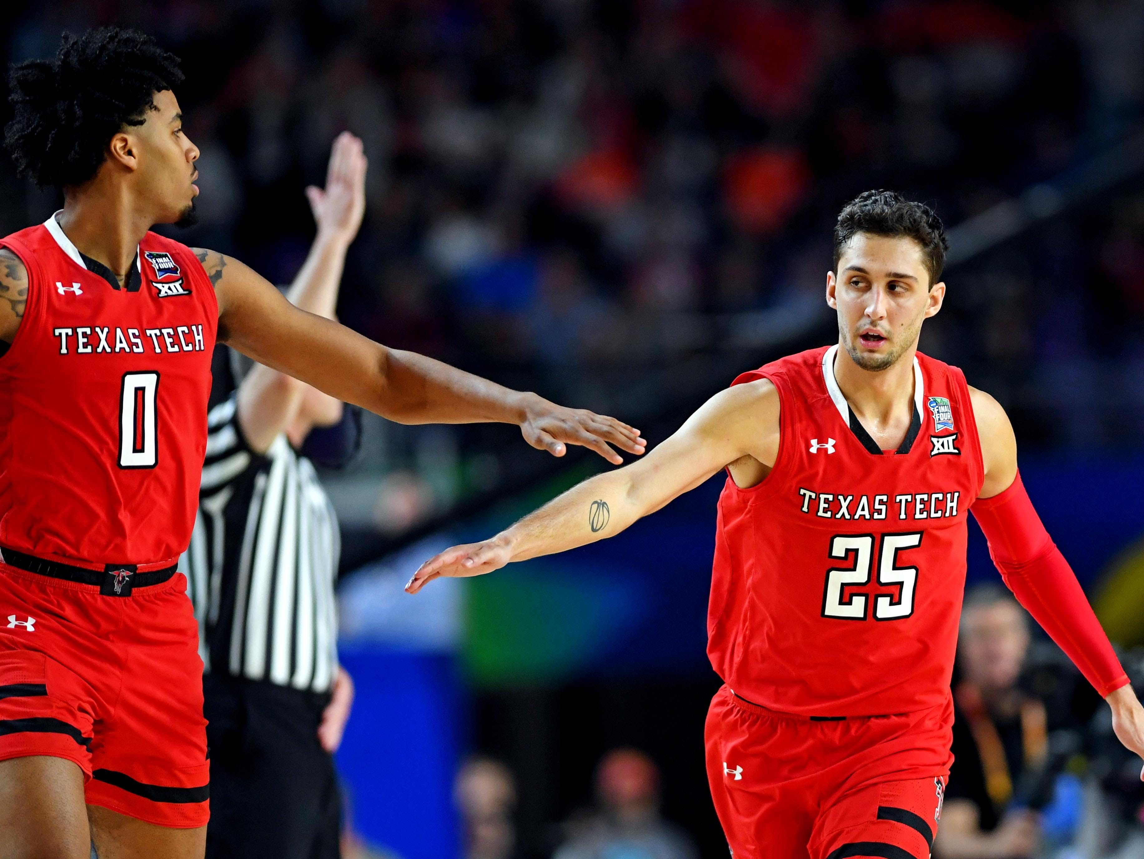 Apr 8, 2019; Minneapolis, MN, USA; Texas Tech Red Raiders guard Davide Moretti (25) and guard Kyler Edwards (0) celebrates during the first half against the Virginia Cavaliers in the championship game of the 2019 men's Final Four at US Bank Stadium. Mandatory Credit: Bob Donnan-USA TODAY Sports
