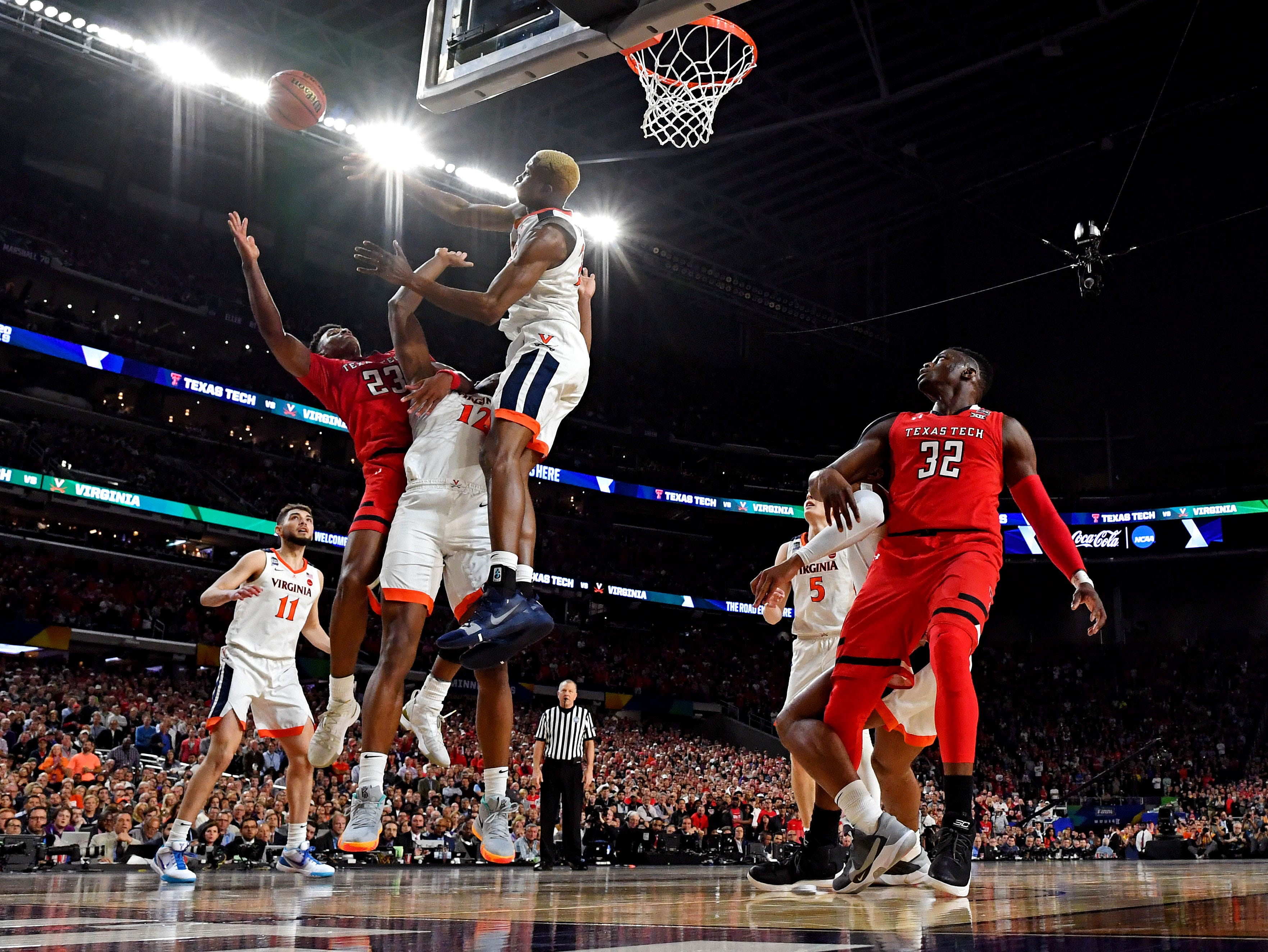 Apr 8, 2019; Minneapolis, MN, USA; Virginia Cavaliers forward Mamadi Diakite (25) blocks the shot of Texas Tech Red Raiders guard Jarrett Culver (23) during overtime in the championship game of the 2019 men's Final Four at US Bank Stadium. Mandatory Credit: Bob Donnan-USA TODAY Sports