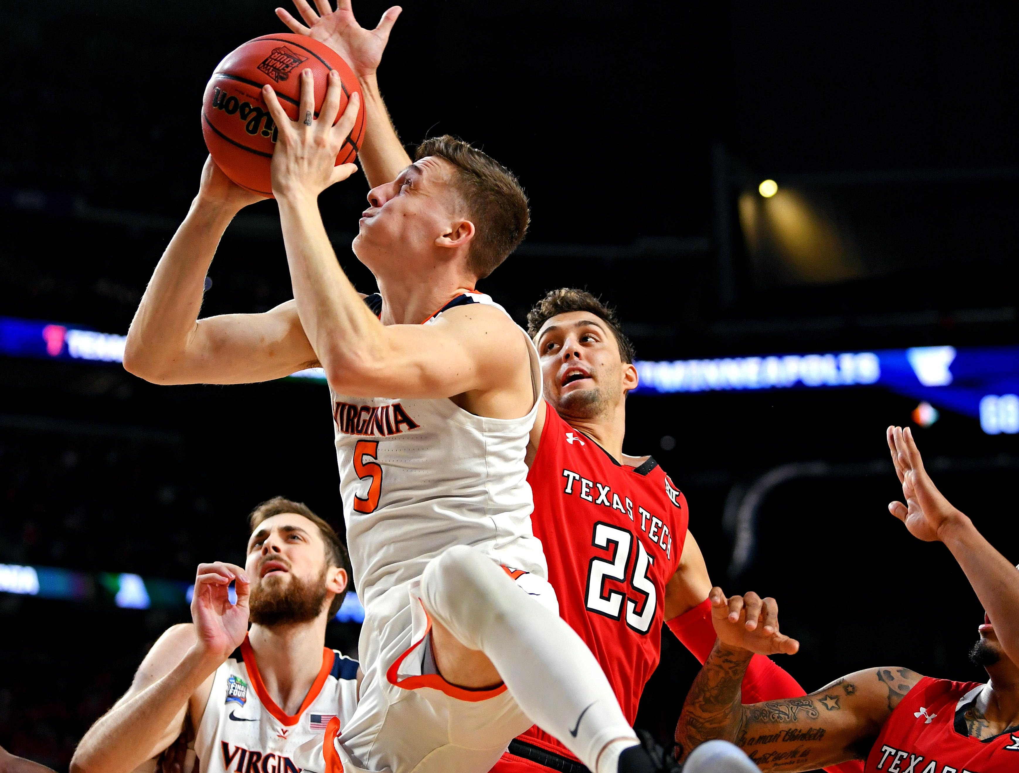 Apr 8, 2019; Minneapolis, MN, USA; Virginia Cavaliers guard Kyle Guy (5) shoots the ball against Texas Tech Red Raiders guard Davide Moretti (25) during the first half  in the championship game of the 2019 men's Final Four at US Bank Stadium. Mandatory Credit: Bob Donnan-USA TODAY Sports