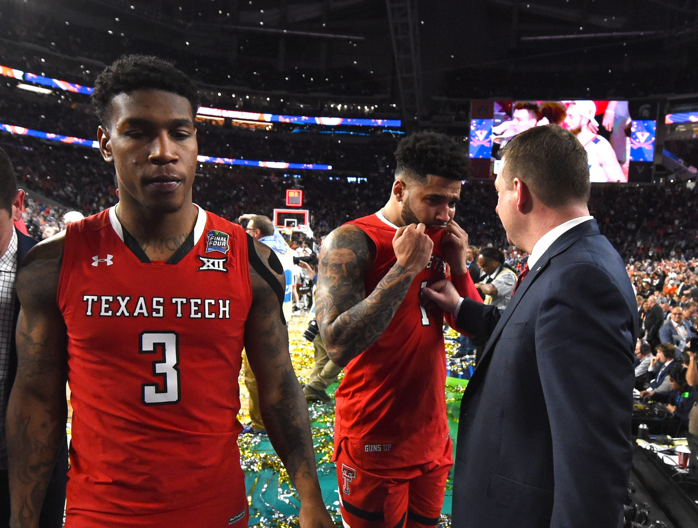 Apr 8, 2019; Minneapolis, MN, USA; Texas Tech Red Raiders head coach Chris Beard consoles guard Brandone Francis (1) after losing to the Virginia Cavaliers in the championship game of the 2019 men's Final Four at US Bank Stadium. Mandatory Credit: Robert Deutsch-USA TODAY Sports