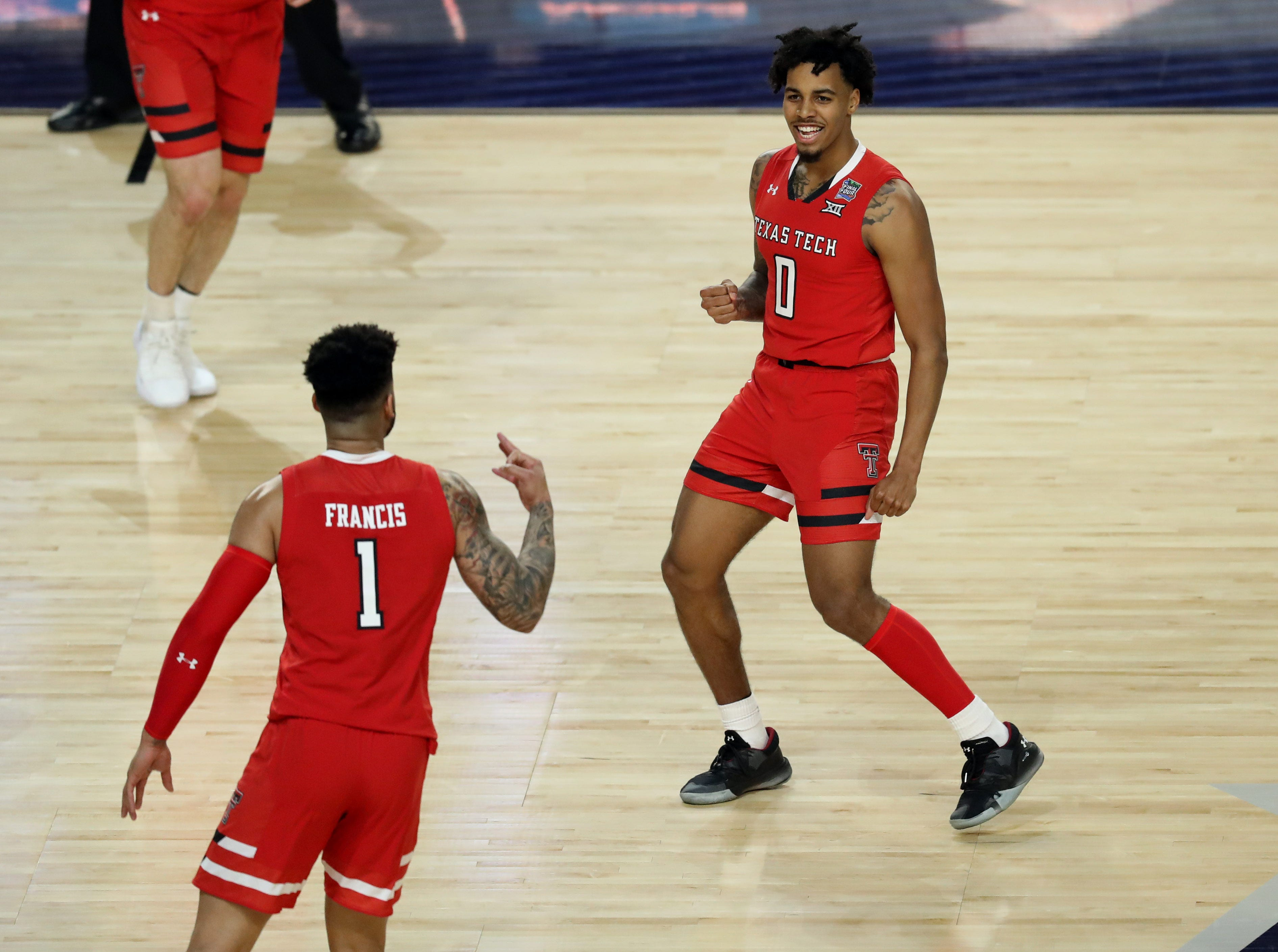 Apr 8, 2019; Minneapolis, MN, USA; Texas Tech Red Raiders guard Brandone Francis (1) and guard Kyler Edwards (0) celebrate during the first half against the Virginia Cavaliers in the championship game of the 2019 men's Final Four at US Bank Stadium. Mandatory Credit: Brace Hemmelgarn-USA TODAY Sports