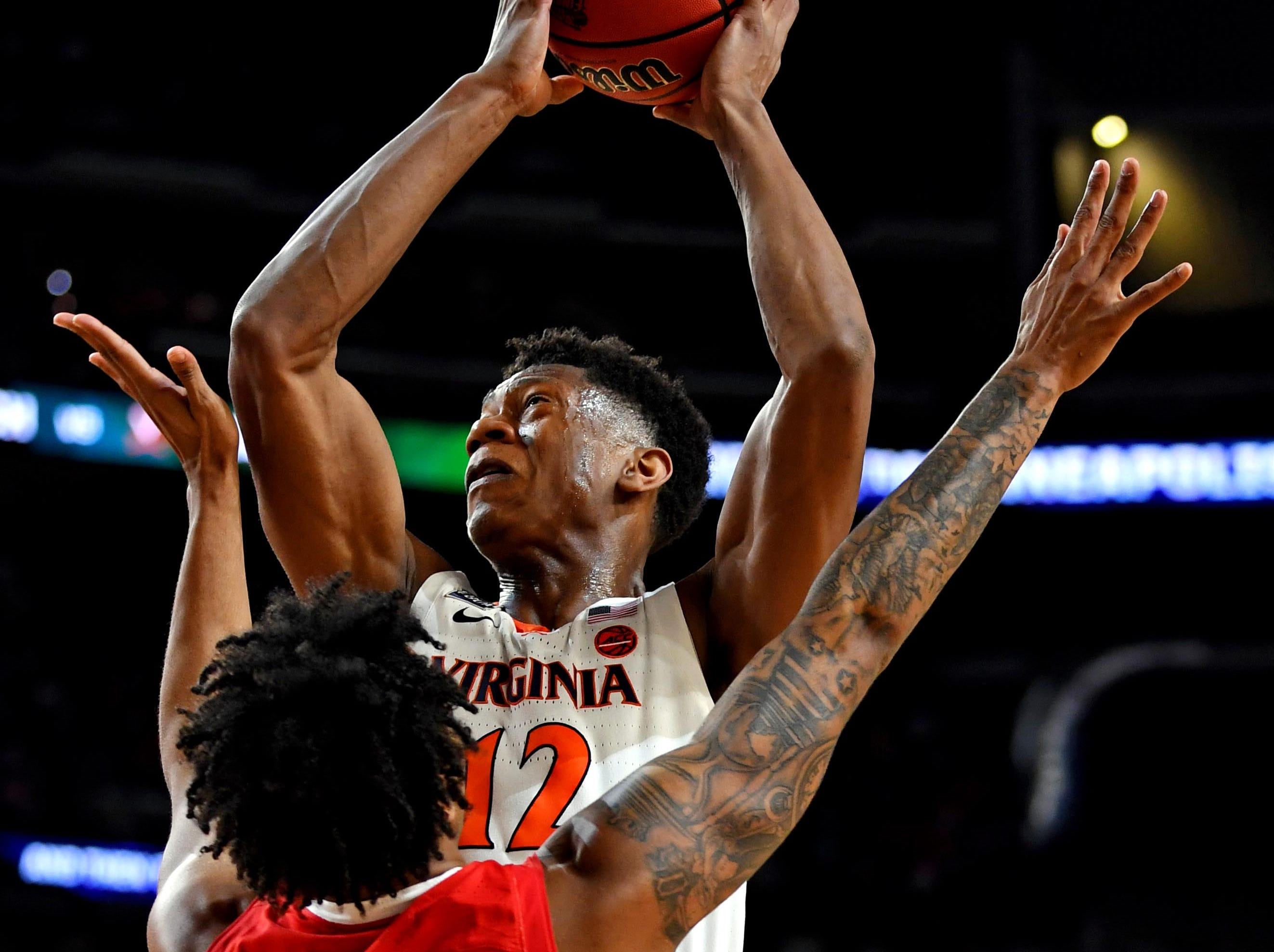 Apr 8, 2019; Minneapolis, MN, USA; Virginia Cavaliers guard De'Andre Hunter (12) drives to the basket against Texas Tech Red Raiders guard Kyler Edwards (0) during the first half in the championship game of the 2019 men's Final Four at US Bank Stadium. Mandatory Credit: Bob Donnan-USA TODAY Sports