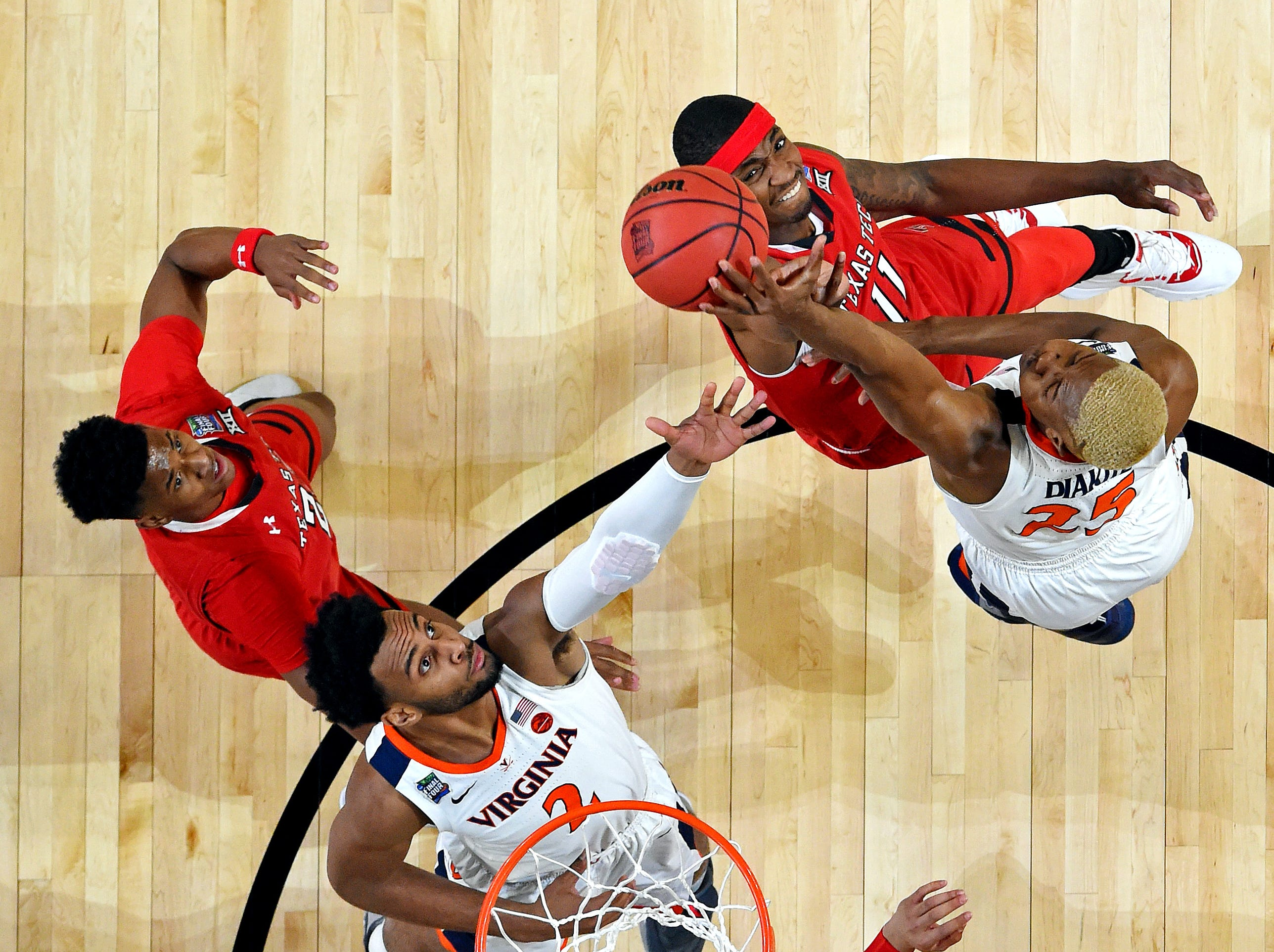 Apr 8, 2019; Minneapolis, MN, USA; Virginia Cavaliers forward Mamadi Diakite (25) blocks a shot by Texas Tech Red Raiders forward Tariq Owens (11) during the first half in the championship game of the 2019 men's Final Four at US Bank Stadium. Mandatory Credit: Bob Donnan-USA TODAY Sports