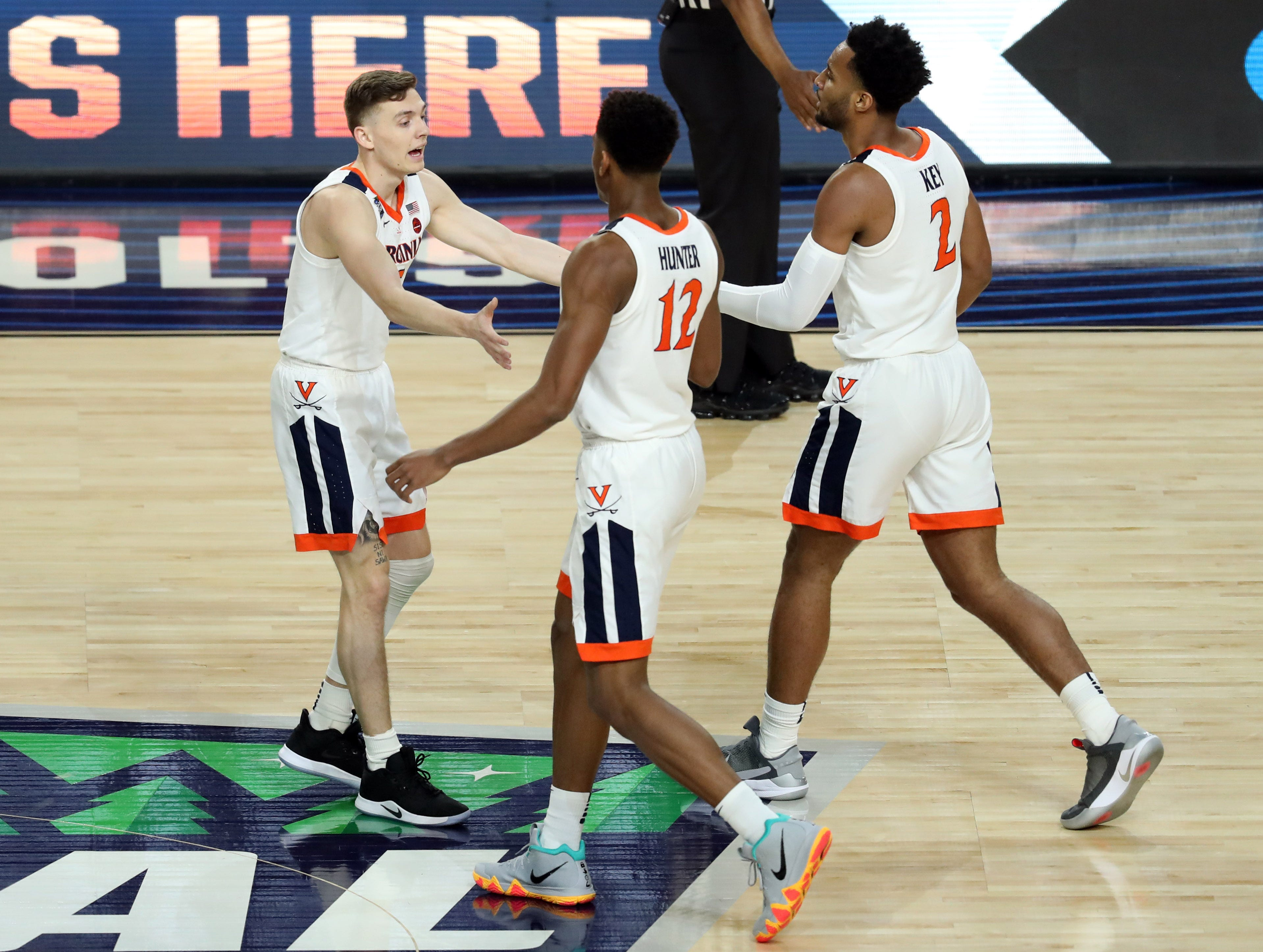 Apr 8, 2019; Minneapolis, MN, USA; The Virginia Cavaliers celebrate during the first half against the Texas Tech Red Raiders in the championship game of the 2019 men's Final Four at US Bank Stadium. Mandatory Credit: Brace Hemmelgarn-USA TODAY Sports