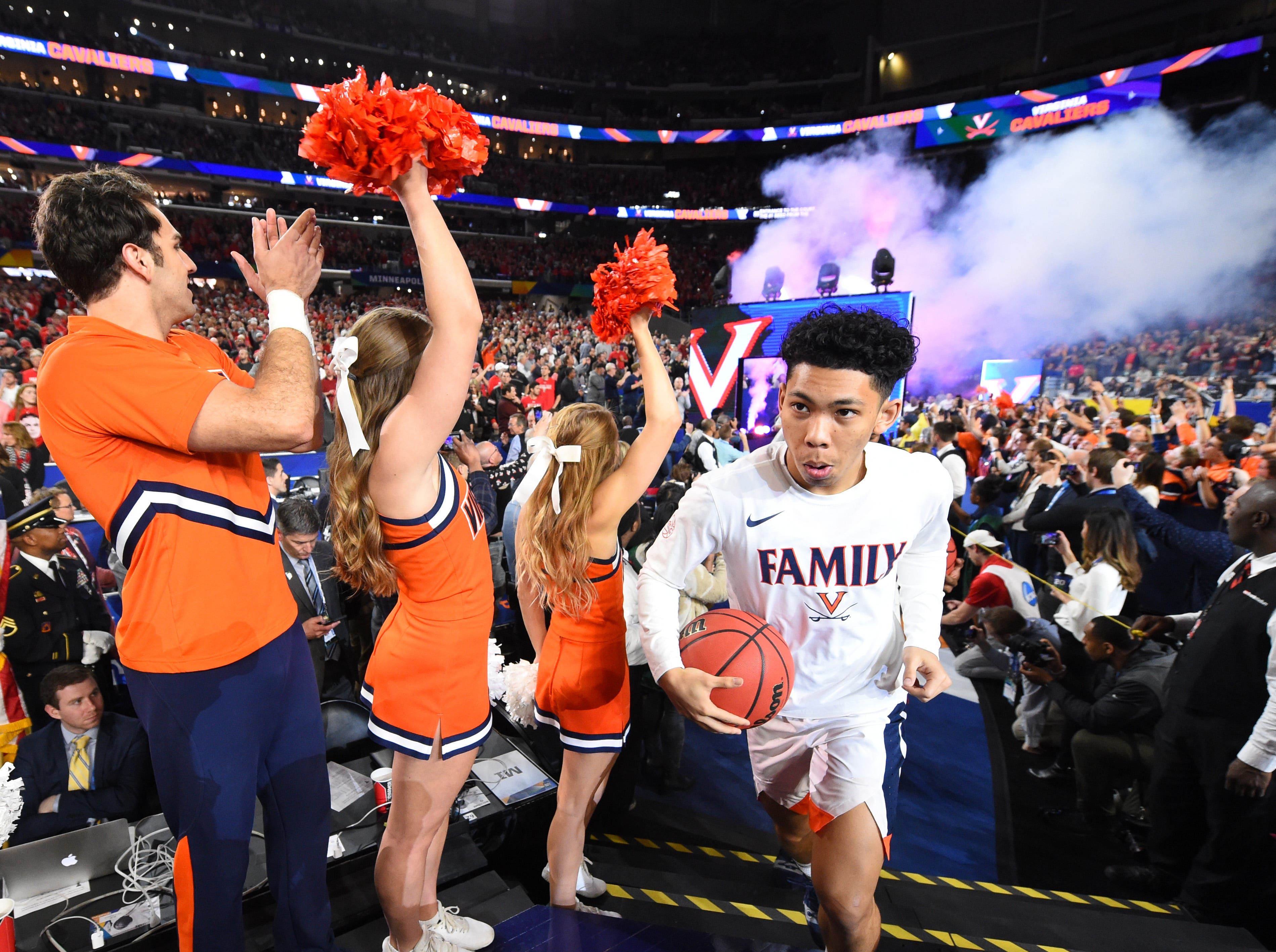 Apr 8, 2019; Minneapolis, MN, USA; Virginia Cavaliers guard Kihei Clark (0) and the Virginia Cavaliers take the floor prior to facing the Texas Tech Red Raiders in the championship game of the 2019 men's Final Four at US Bank Stadium. Mandatory Credit: Robert Deutsch-USA TODAY Sports