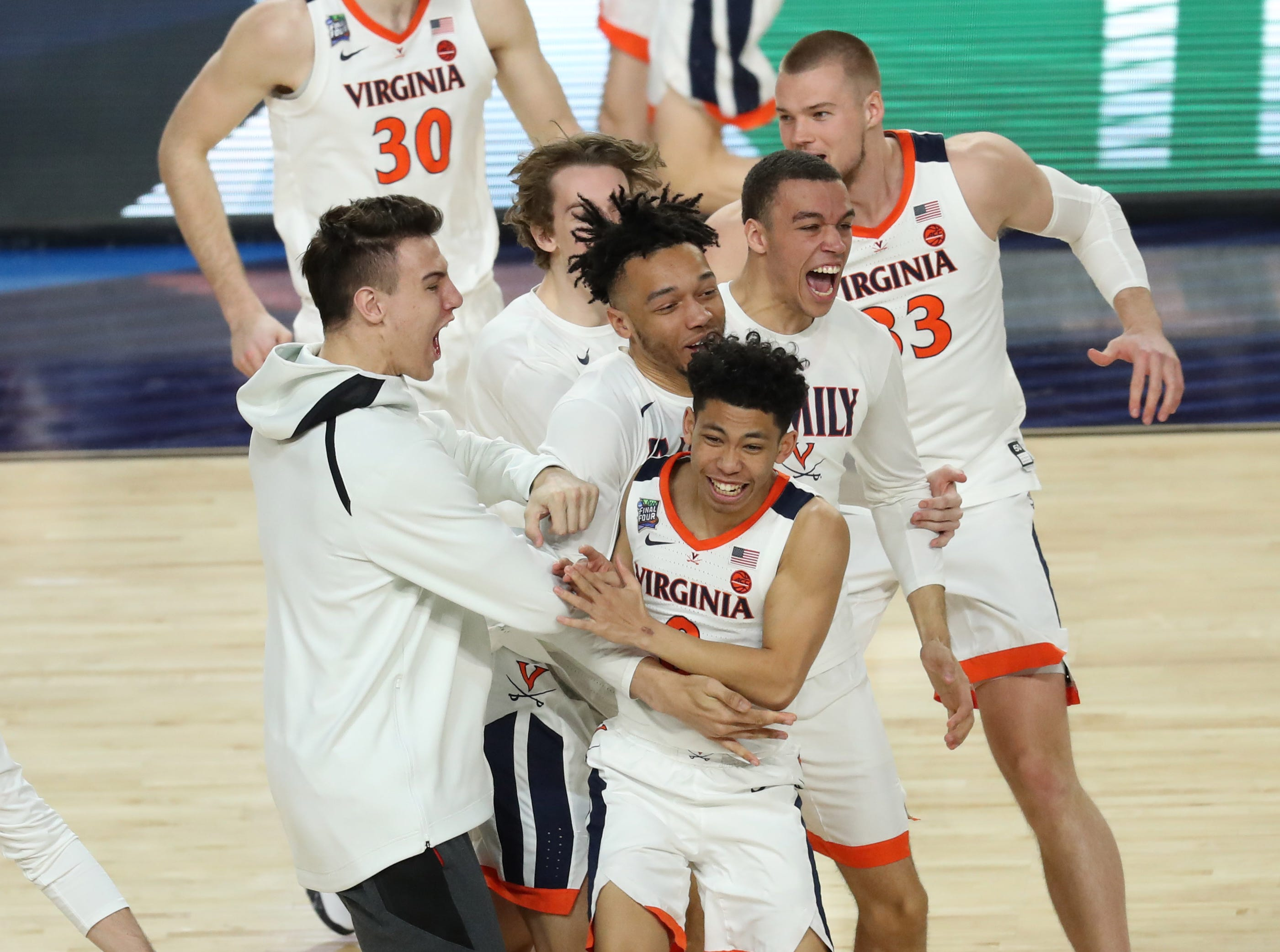 Apr 8, 2019; Minneapolis, MN, USA; Virginia Cavaliers guard Kihei Clark (0) and teammates celebrate after defeating the Texas Tech Red Raiders in the championship game of the 2019 men's Final Four at US Bank Stadium. Mandatory Credit: Brace Hemmelgarn-USA TODAY Sports