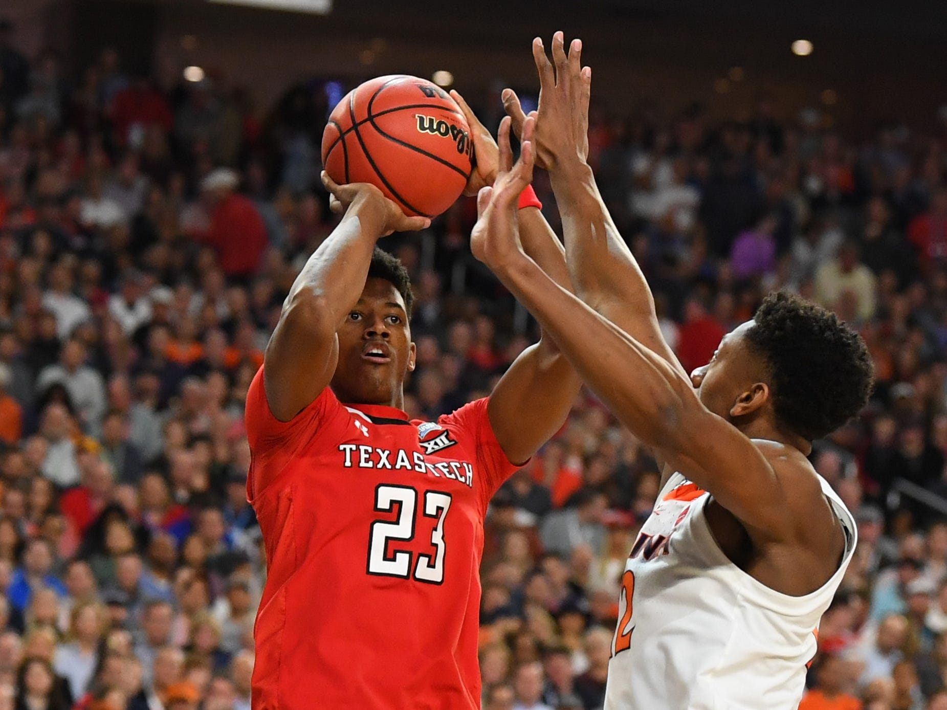 Apr 8, 2019; Minneapolis, MN, USA; Texas Tech Red Raiders guard Jarrett Culver (23) shoots the ball defended by Virginia Cavaliers guard De'Andre Hunter (12) in the championship game of the 2019 men's Final Four at US Bank Stadium. Mandatory Credit: Robert Deutsch-USA TODAY Sports