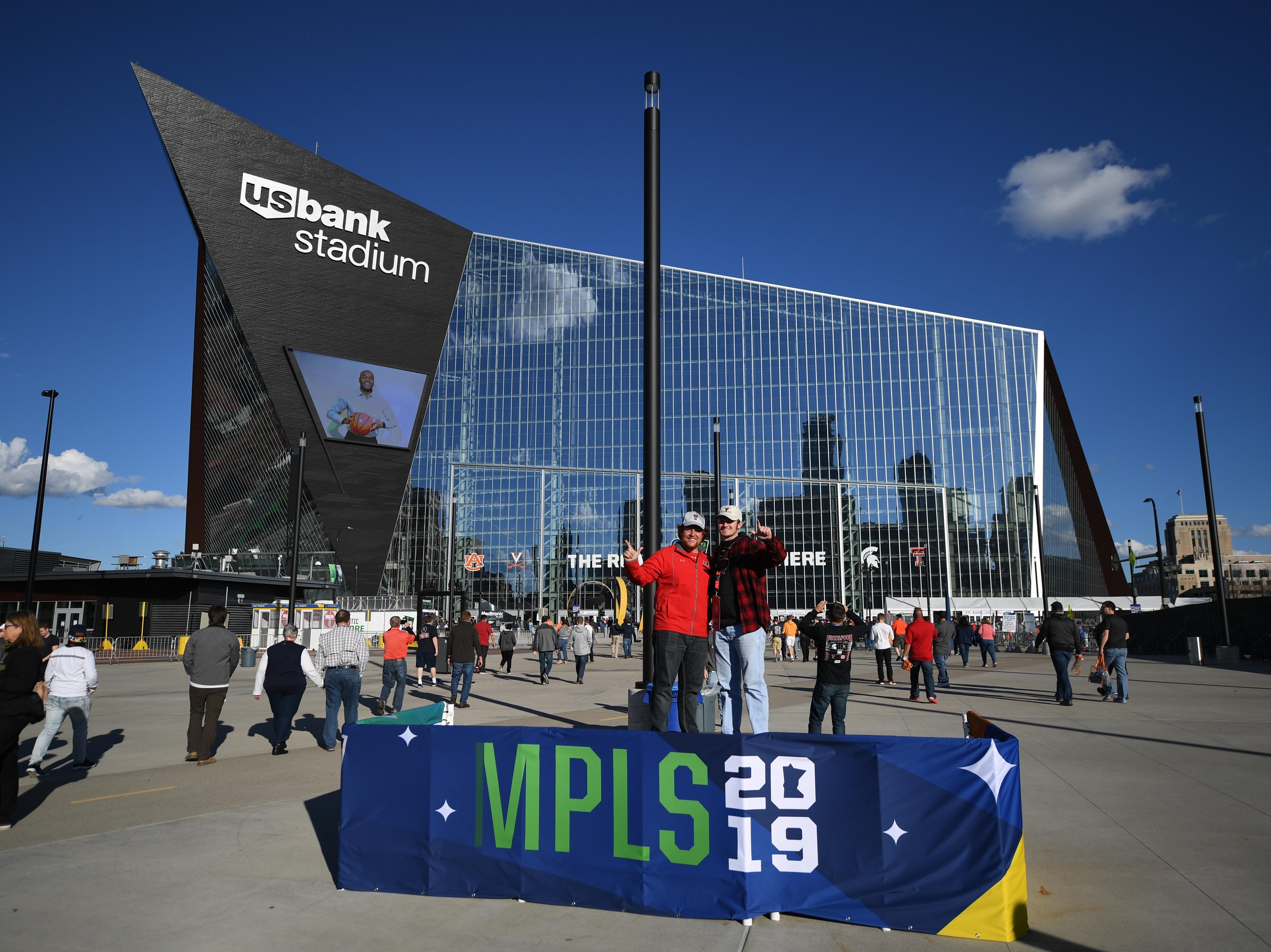 Apr 8, 2019; Minneapolis, MN, USA; Texas Tech Red Raiders fans pose for a photo outside before the championship game of the 2019 men's Final Four against the Virginia Cavaliers at US Bank Stadium. Mandatory Credit: Shanna Lockwood-USA TODAY Sports