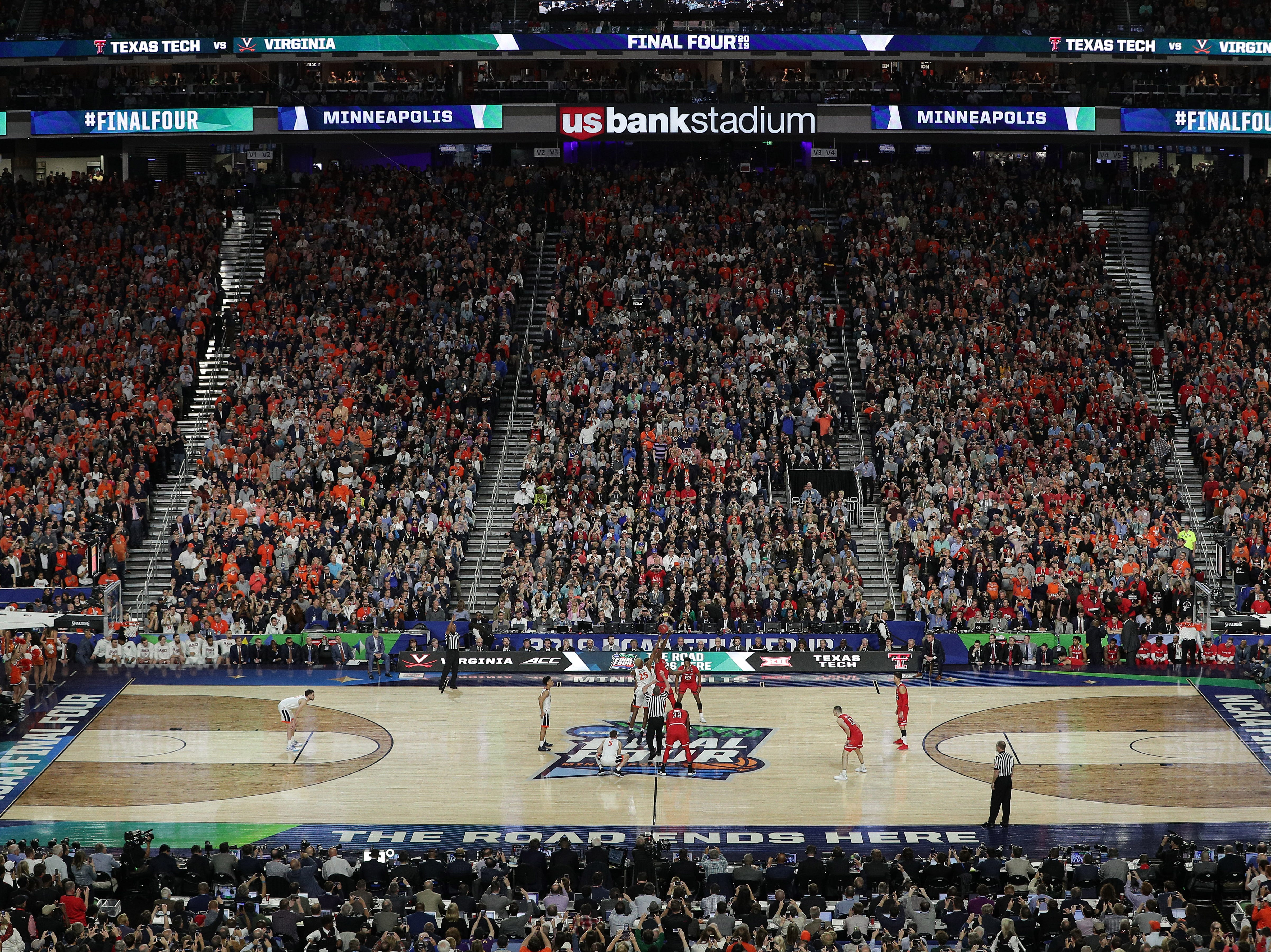 Apr 8, 2019; Minneapolis, MN, USA; The ball is tipped off in the championship game of the 2019 men's Final Four between the Virginia Cavaliers and the Texas Tech Red Raiders at US Bank Stadium. Mandatory Credit: Brace Hemmelgarn-USA TODAY Sports