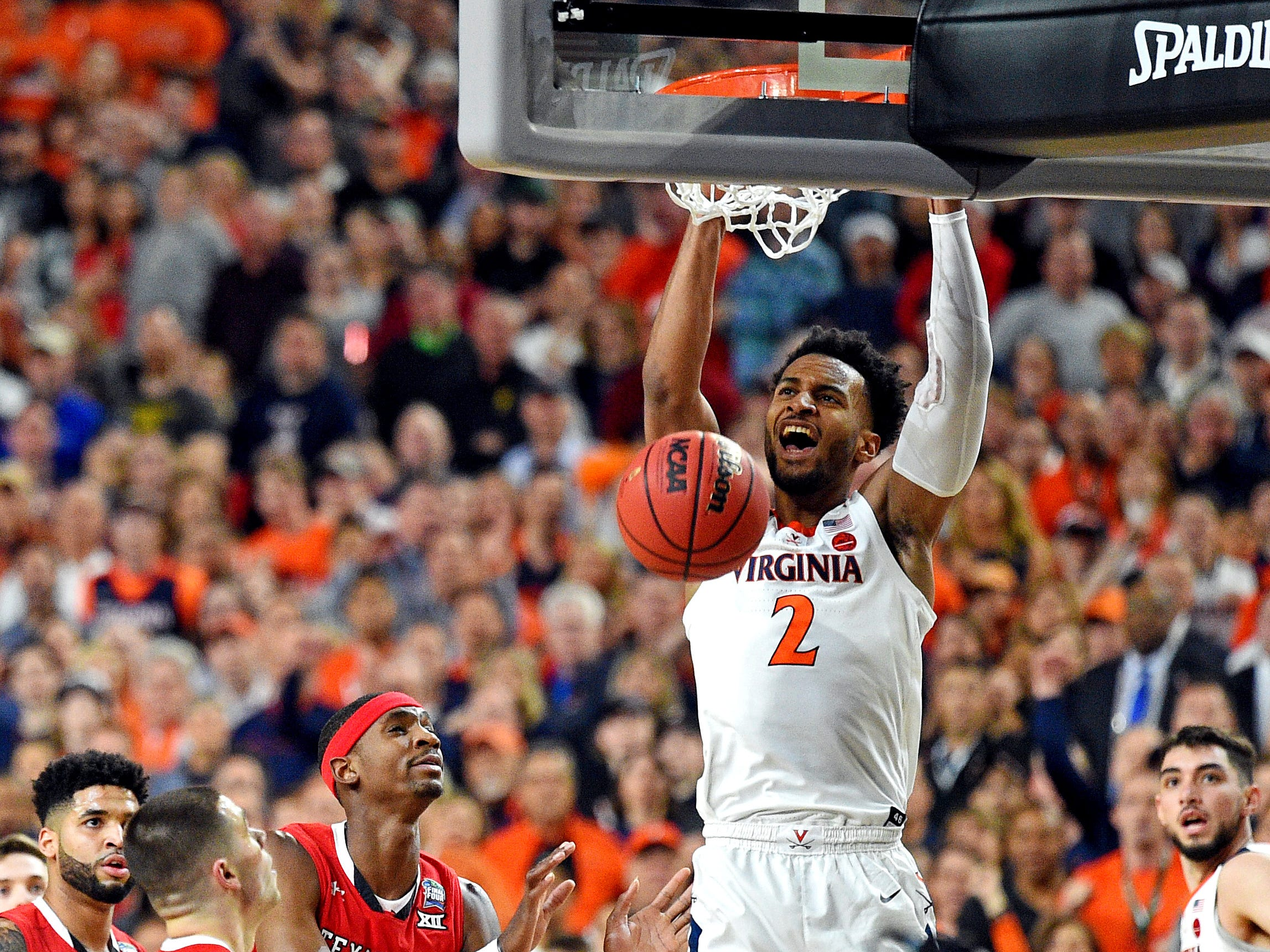 Apr 8, 2019; Minneapolis, MN, USA; Virginia Cavaliers guard Braxton Key (2) dunks the ball against Texas Tech Red Raiders guard Matt Mooney (13) during the first half in the championship game of the 2019 men's Final Four at US Bank Stadium. Mandatory Credit: Bob Donnan-USA TODAY Sports
