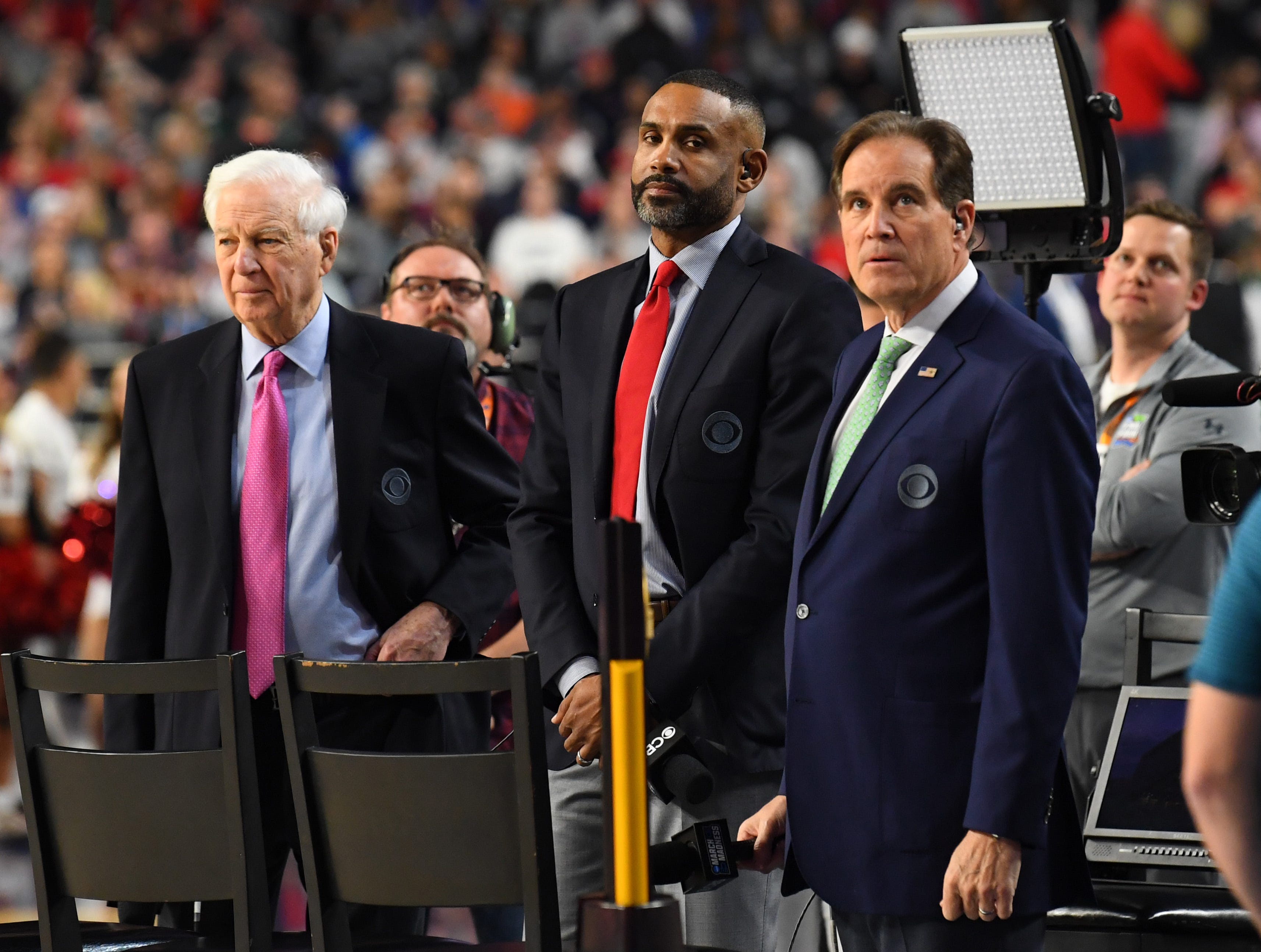 Apr 8, 2019; Minneapolis, MN, USA; CBS broadcasters Bill Raftery (left) Grant Hill (center) Jim Nantz (right) prior to the game between the Texas Tech Red Raiders and the Virginia Cavaliers in the championship game of the 2019 men's Final Four at US Bank Stadium. Mandatory Credit: Robert Deutsch-USA TODAY Sports